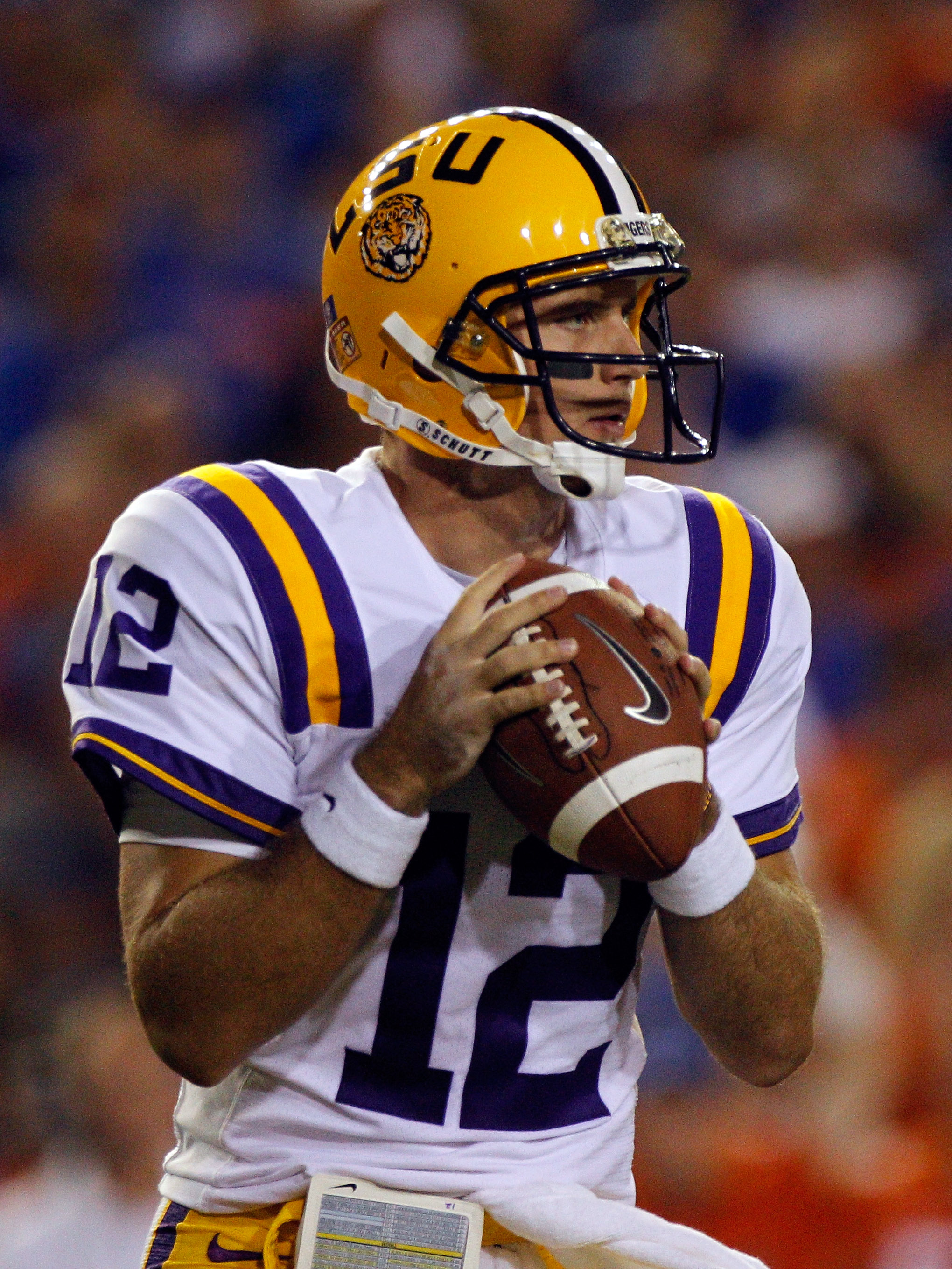 GAINESVILLE, FL - OCTOBER 09:  Quarterback Jarrett Lee #12 of the Louisiana State University Tigers attempts a pass during the game against the Florida Gators at Ben Hill Griffin Stadium on October 9, 2010 in Gainesville, Florida.  (Photo by Sam Greenwood