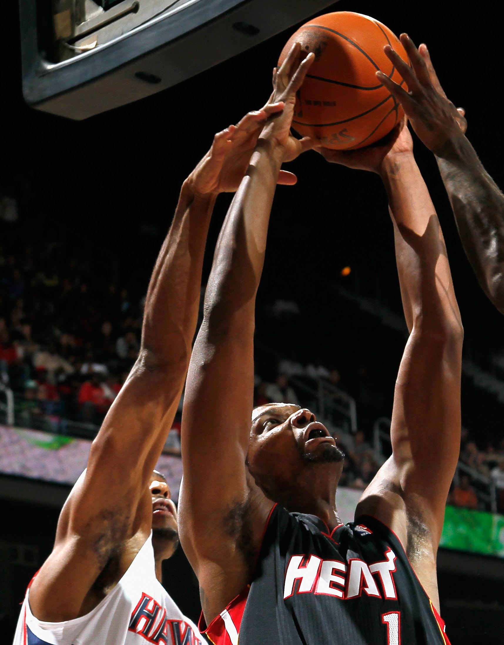 ATLANTA - OCTOBER 21:  Chris Bosh #1 of the Miami Heat attacks the basket against Al Horford #15 of the Atlanta Hawks at Philips Arena on October 21, 2010 in Atlanta, Georgia.  (Photo by Kevin C. Cox/Getty Images)