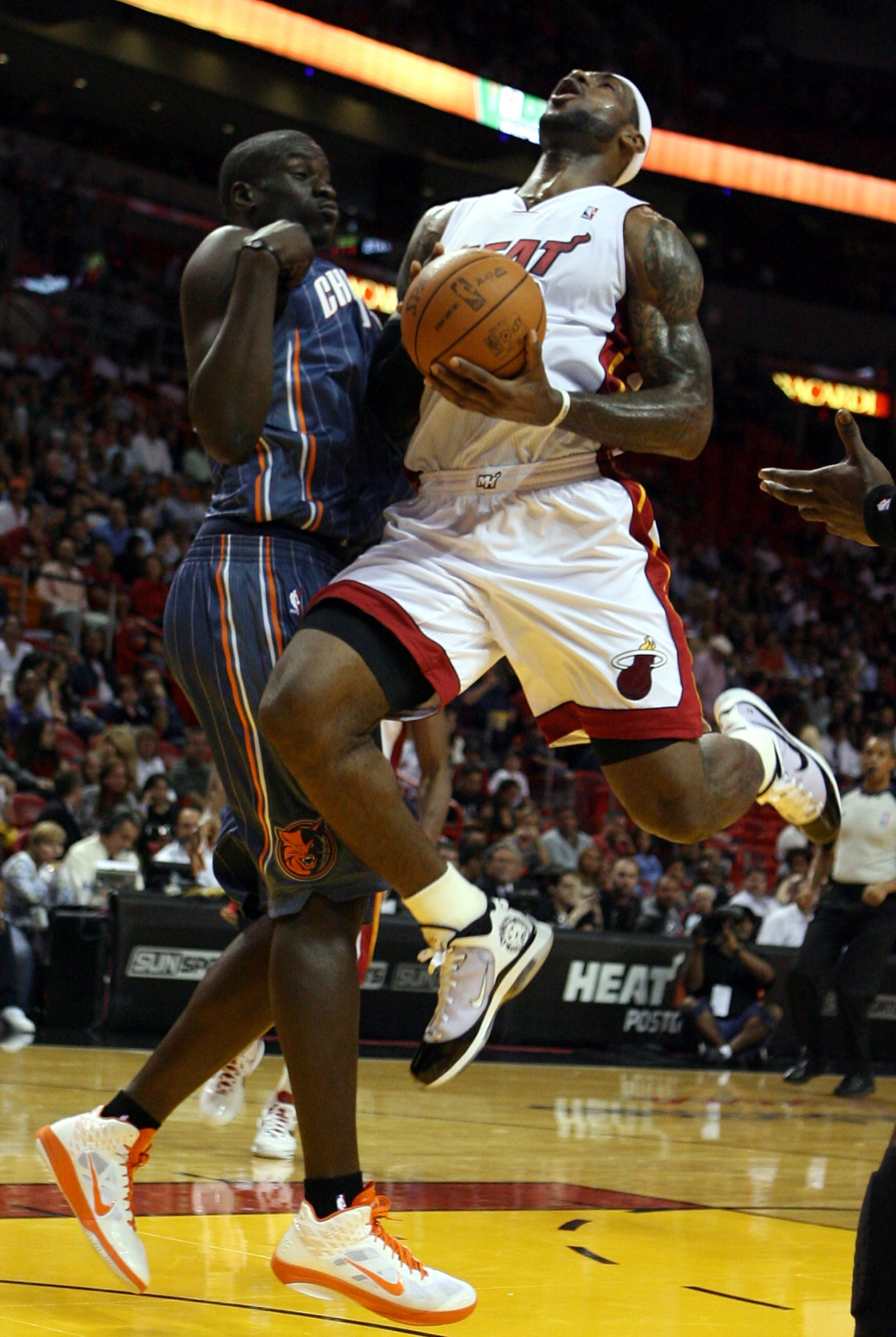 MIAMI - OCTOBER 18:  Forward LeBron James #6 of the Miami Heat is fouled by Boris Diaw #32 of the Charlotte Bobcats at American Airlines Arena on October 18, 2010 in Miami, Florida. NOTE TO USER: User expressly acknowledges and agrees that, by downloading