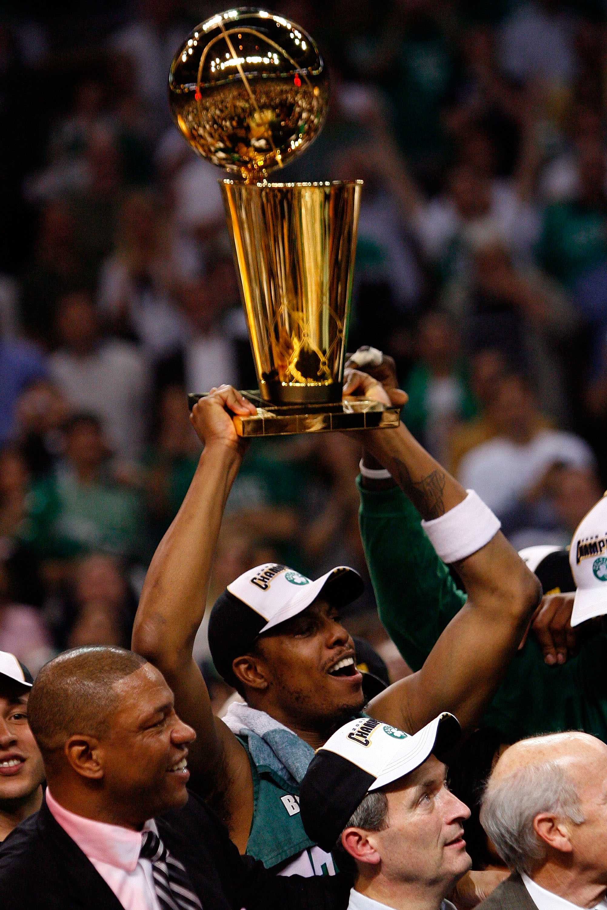 BOSTON - JUNE 17:  Paul Pierce #34 of the Boston Celtics holds up the Larry O'Brien trophy after Game Six of the 2008 NBA Finals against the Los Angeles Lakers on June 17, 2008 at TD Banknorth Garden in Boston, Massachusetts. The Celtics defeated the Lake