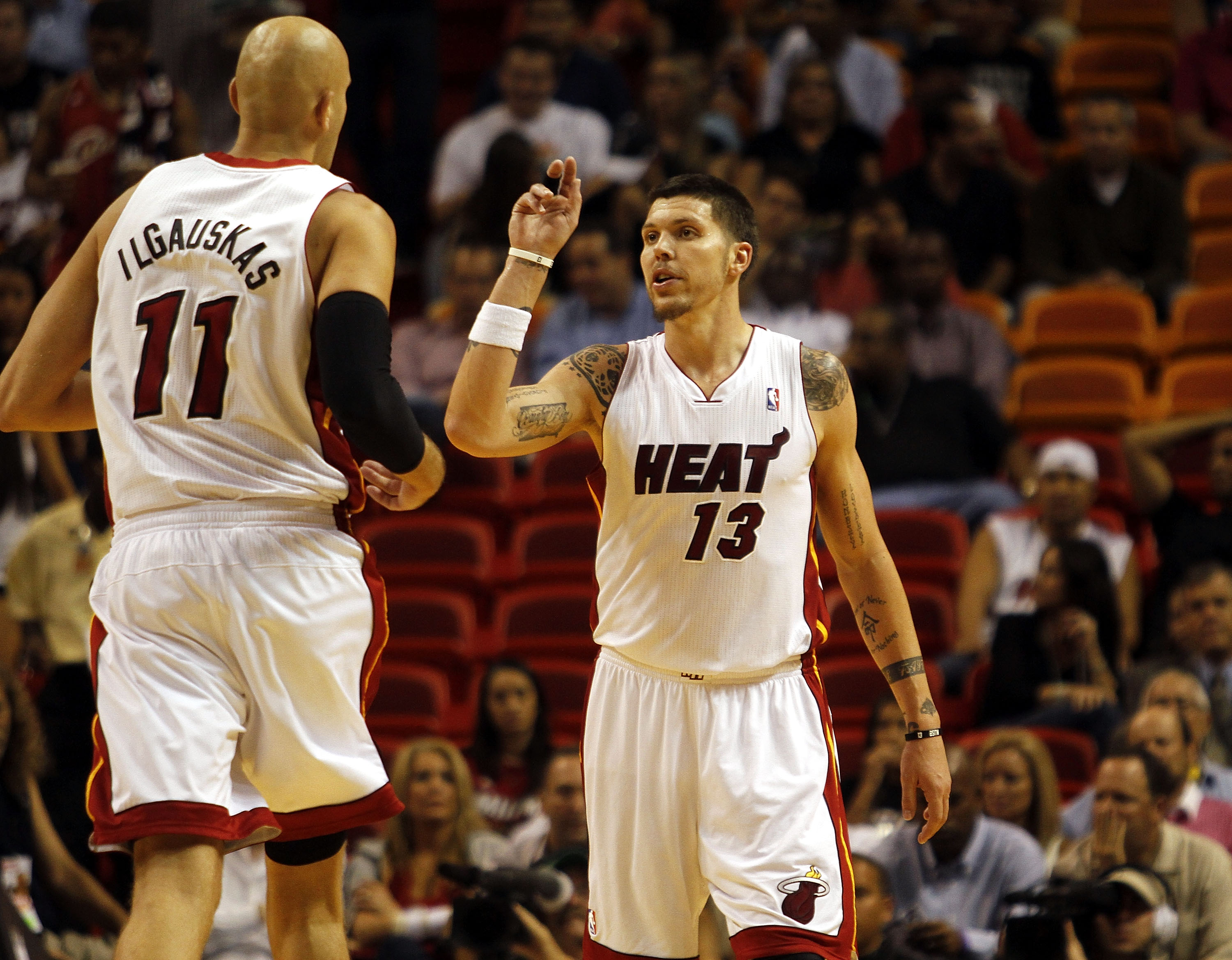 MIAMI - OCTOBER 18:  Center Zydrunas Ilgauskas #11 and Forward Mike Miller #13 of the Miami Heat celebrate against the Charlotte Bobcats on October 18, 2010 at American Airlines Arena in Miami, Florida. NOTE TO USER: User expressly acknowledges and agrees