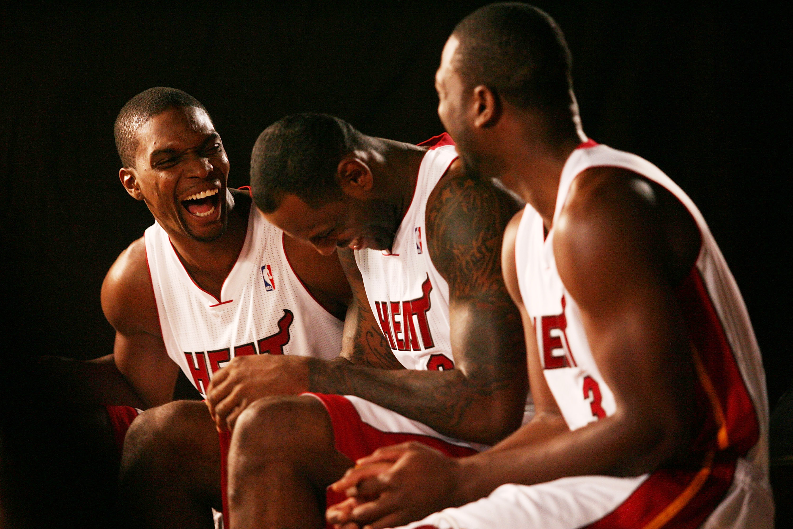 MIAMI - SEPTEMBER 27:  (L-R) Chris Bosh, LeBron James and Dwyane Wade of the Miami Heat answers questions during media day at the Bank United Center on September 27, 2010 in Miami, Florida.  (Photo by Marc Serota/Getty Images)
