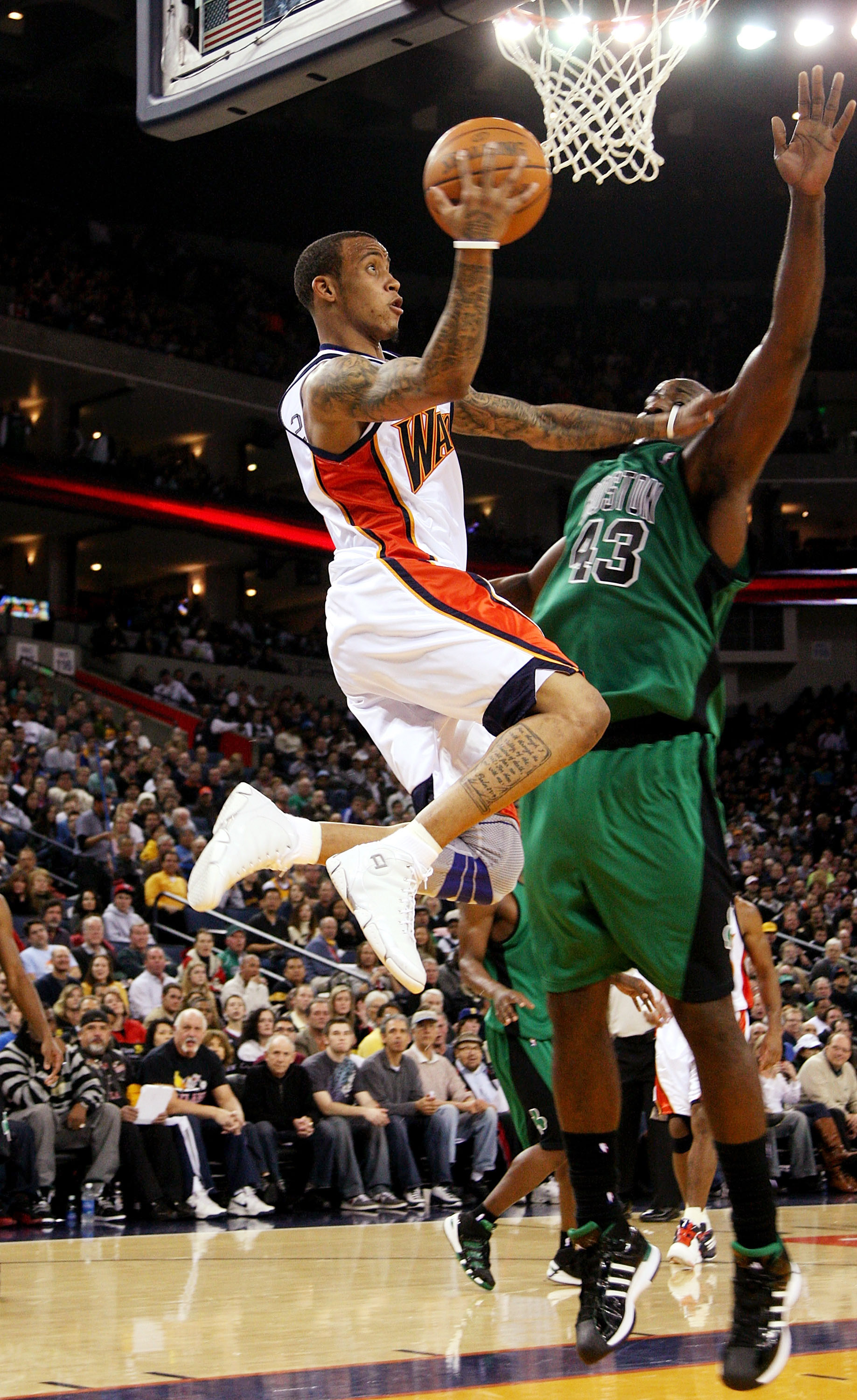 OAKLAND, CA - DECEMBER 28: Monta Ellis #8 of the Golden State Warriors shoots over Kendrick Perkins #43 of the Boston Celtics during an NBA game at Oracle Arena on December 28, 2009 in Oakland, California. NOTE TO USER: User expressly acknowledges and agr