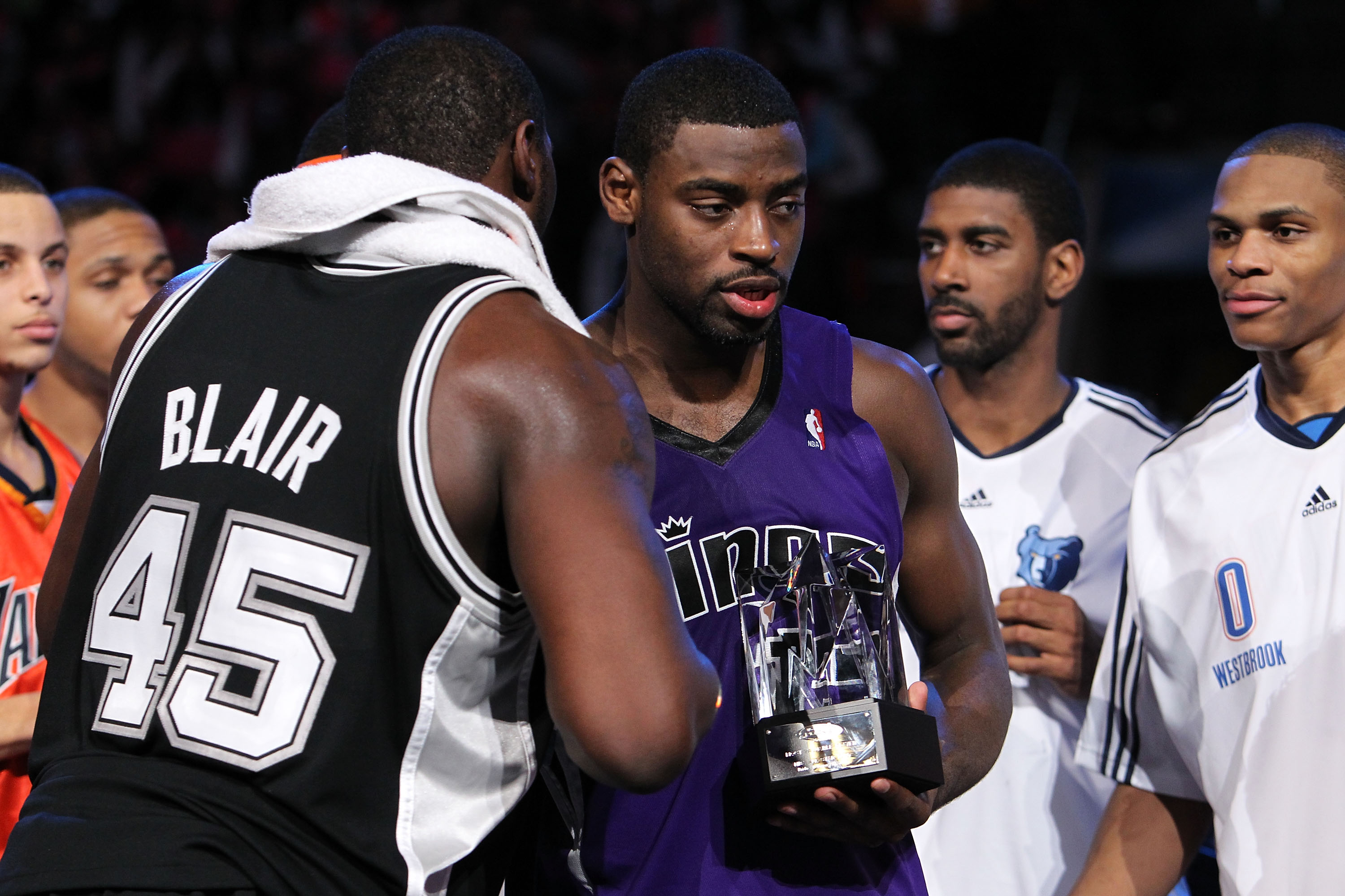 DALLAS - FEBRUARY 12:  DeJuan Blair #45 of the Rookie team congratulates teammate Tyreke Evans #13 on receiving the MVP trophy after defeating the Sophomore team during the second half of the T-Mobile Rookie Challenge & Youth Jam part of 2010 NBA All-Star