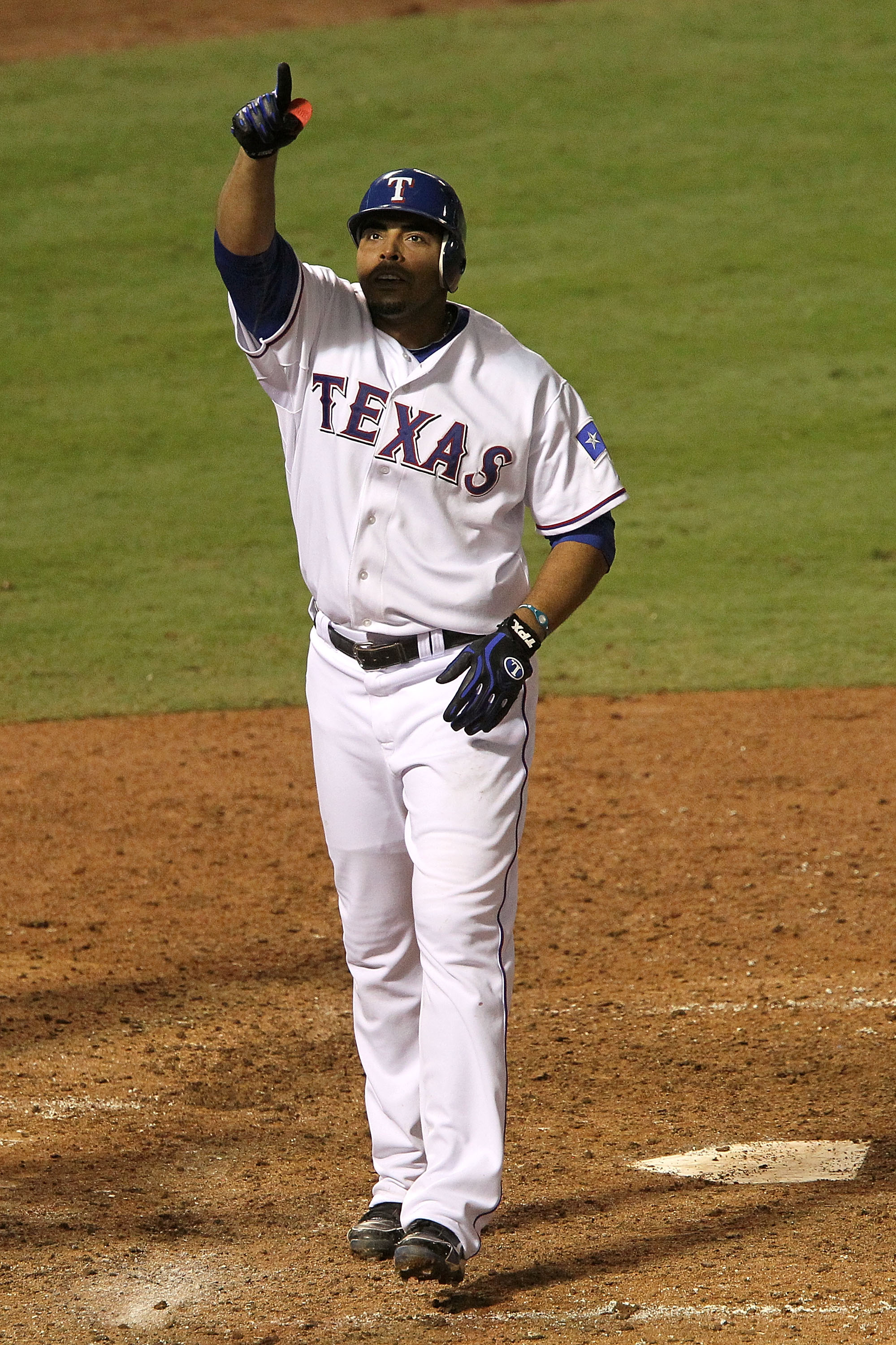ARLINGTON, TX - OCTOBER 22:  Nelson Cruz #17 of the Texas Rangers celebrates as he crosses home plate and scores on his 2-run home run in the bottom of the fifth inning against the New York Yankees in Game Six of the ALCS during the 2010 MLB Playoffs at R