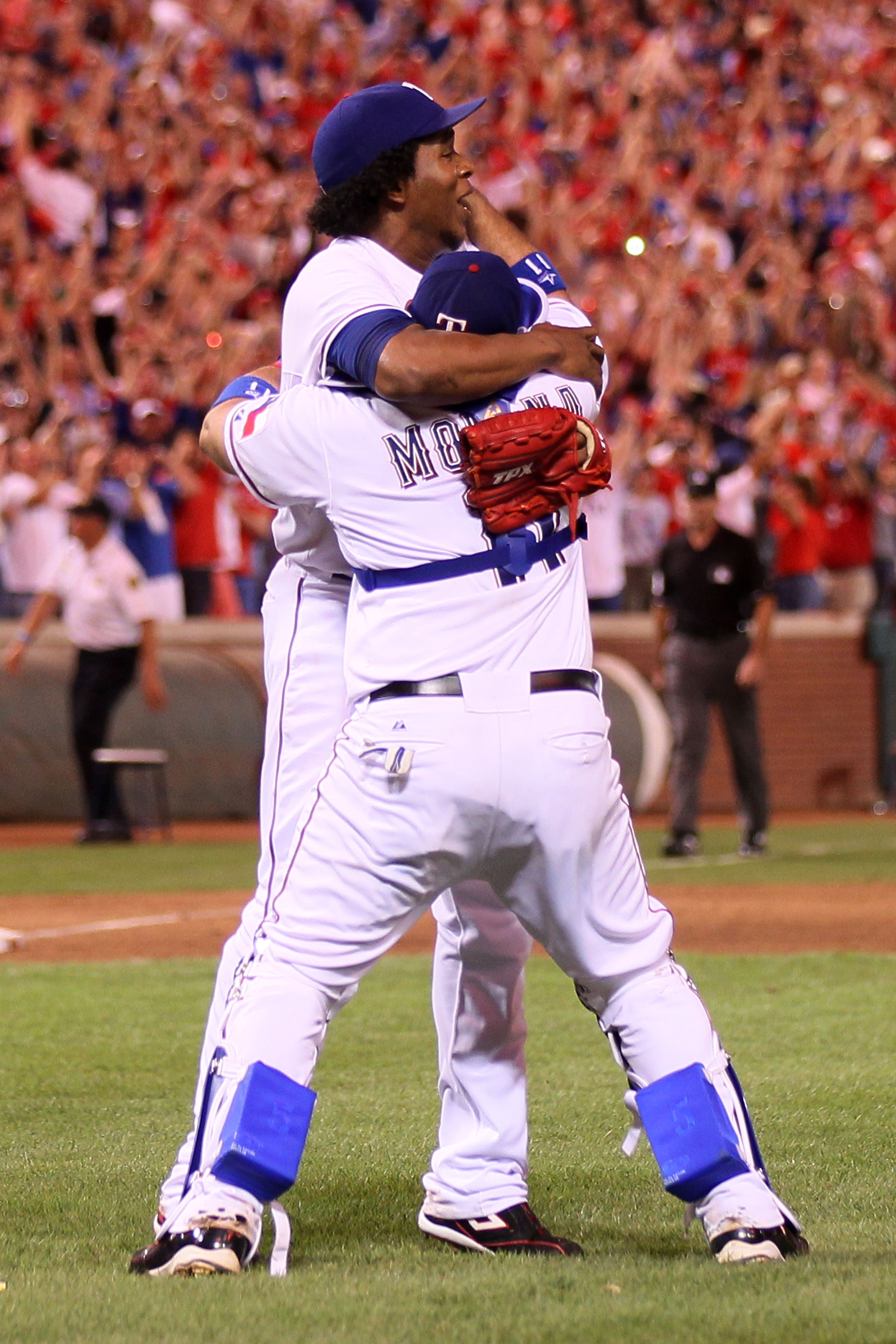 ARLINGTON, TX - OCTOBER 22:  Bengie Molina #11 and Neftali Feliz #30 of the Texas Rangers celebrate after defeating the New York Yankees 6-1 in Game Six of the ALCS during the 2010 MLB Playoffs at Rangers Ballpark in Arlington on October 22, 2010 in Arlin