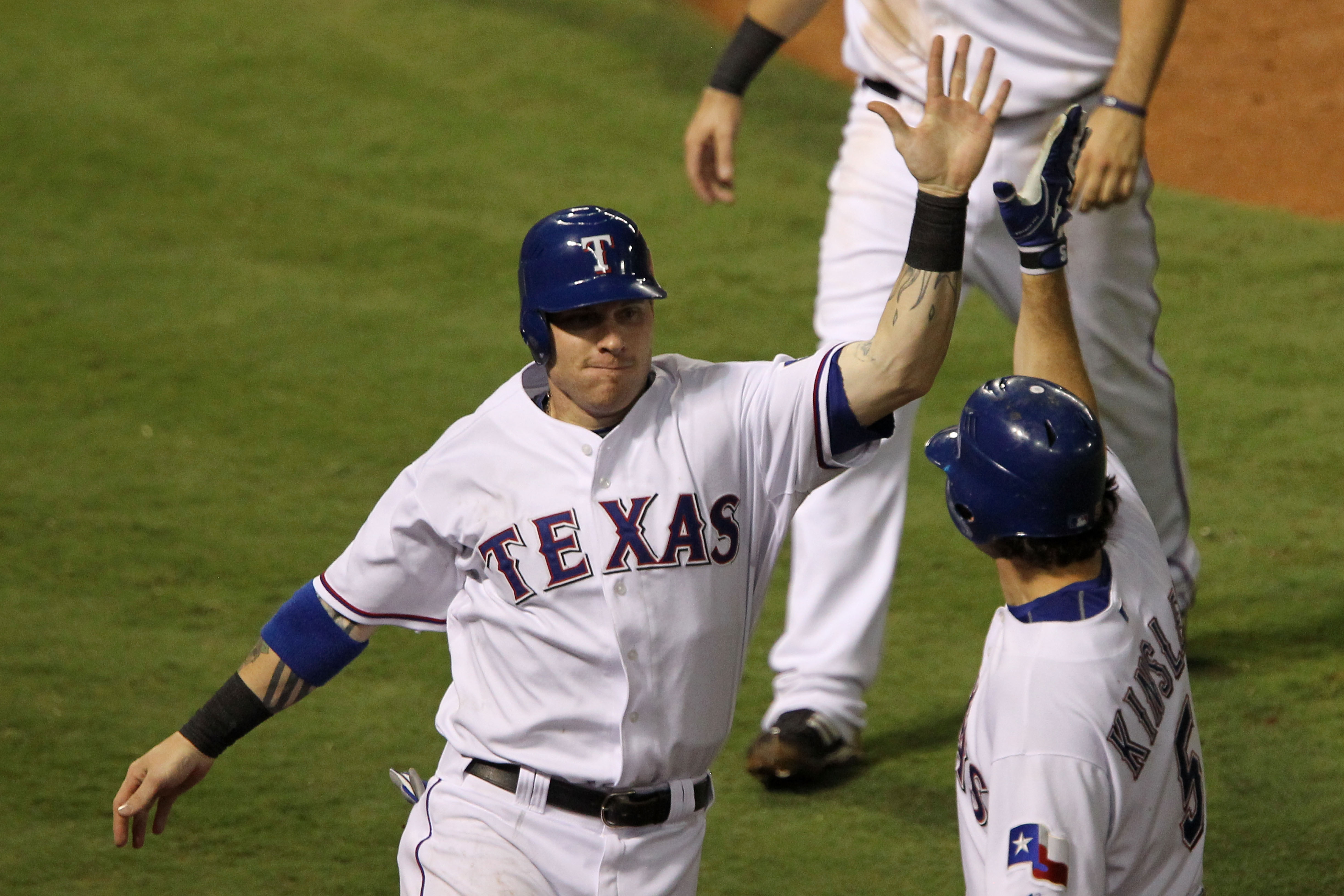 ARLINGTON, TX - OCTOBER 22:  Josh Hamilton #32 of the Texas Rangers celebrates with Ian Kinsler #5 after scoring on a double by Vladimir Guerrero #27 in the fifth inning of Game Six of the ALCS against the New York Yankees during the 2010 MLB Playoffs at