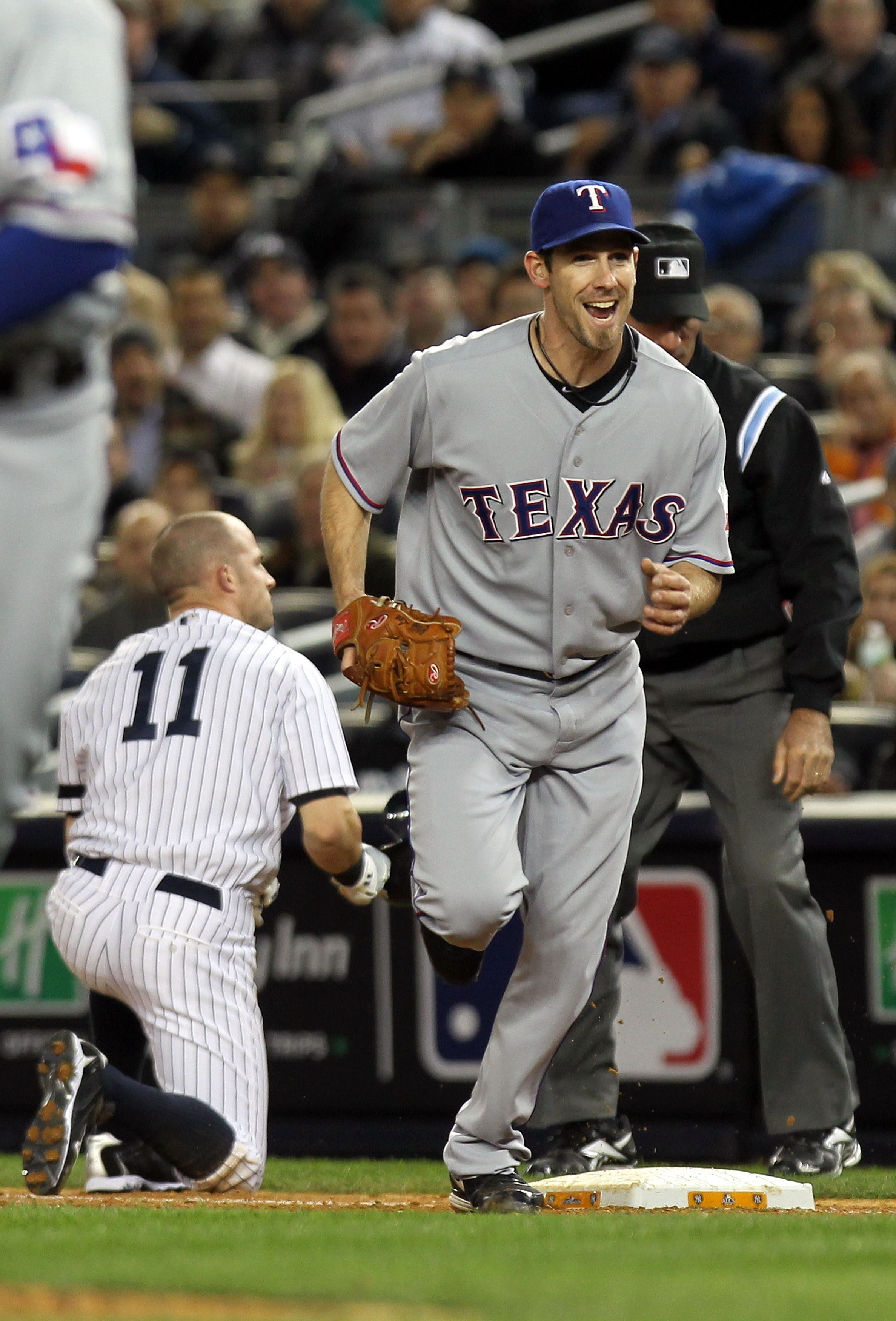 NEW YORK - OCTOBER 18:  Cliff Lee #33 of the Texas Rangers reacts after he forced out Brett Gardner #11 of the New York Yankees at first base in the bottom of the third inning of Game Three of the ALCS during the 2010 MLB Playoffs at Yankee Stadium on Oct
