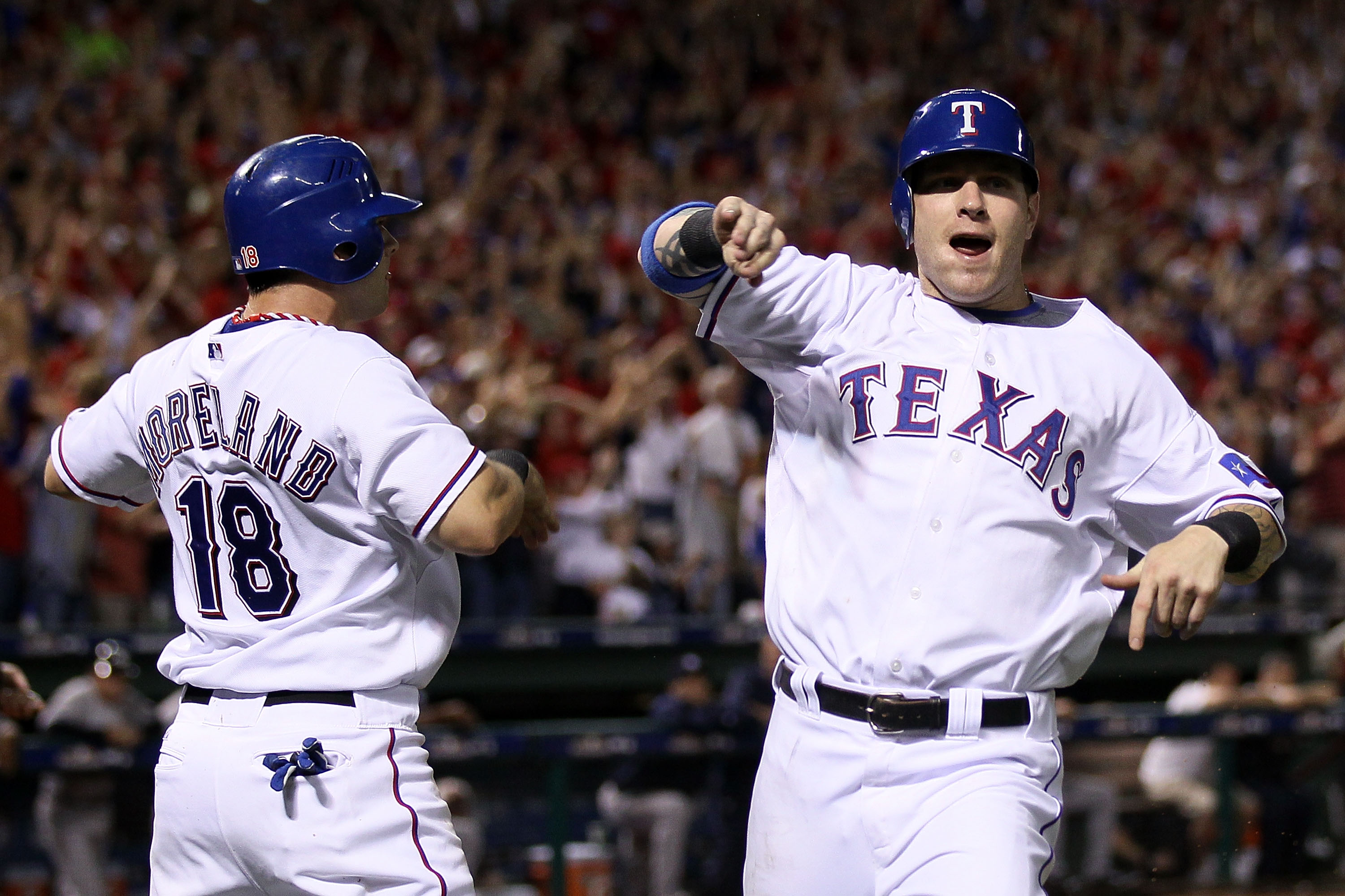 ARLINGTON, TX - OCTOBER 22:  (L-R) Mitch Moreland #18 and Josh Hamilton #32 of the Texas Rangers celebrate after they scored on a 2-run double by Vladimir Guerrero #27 ini the bottom of the fifth inning against the New York Yankees in Game Six of the ALCS