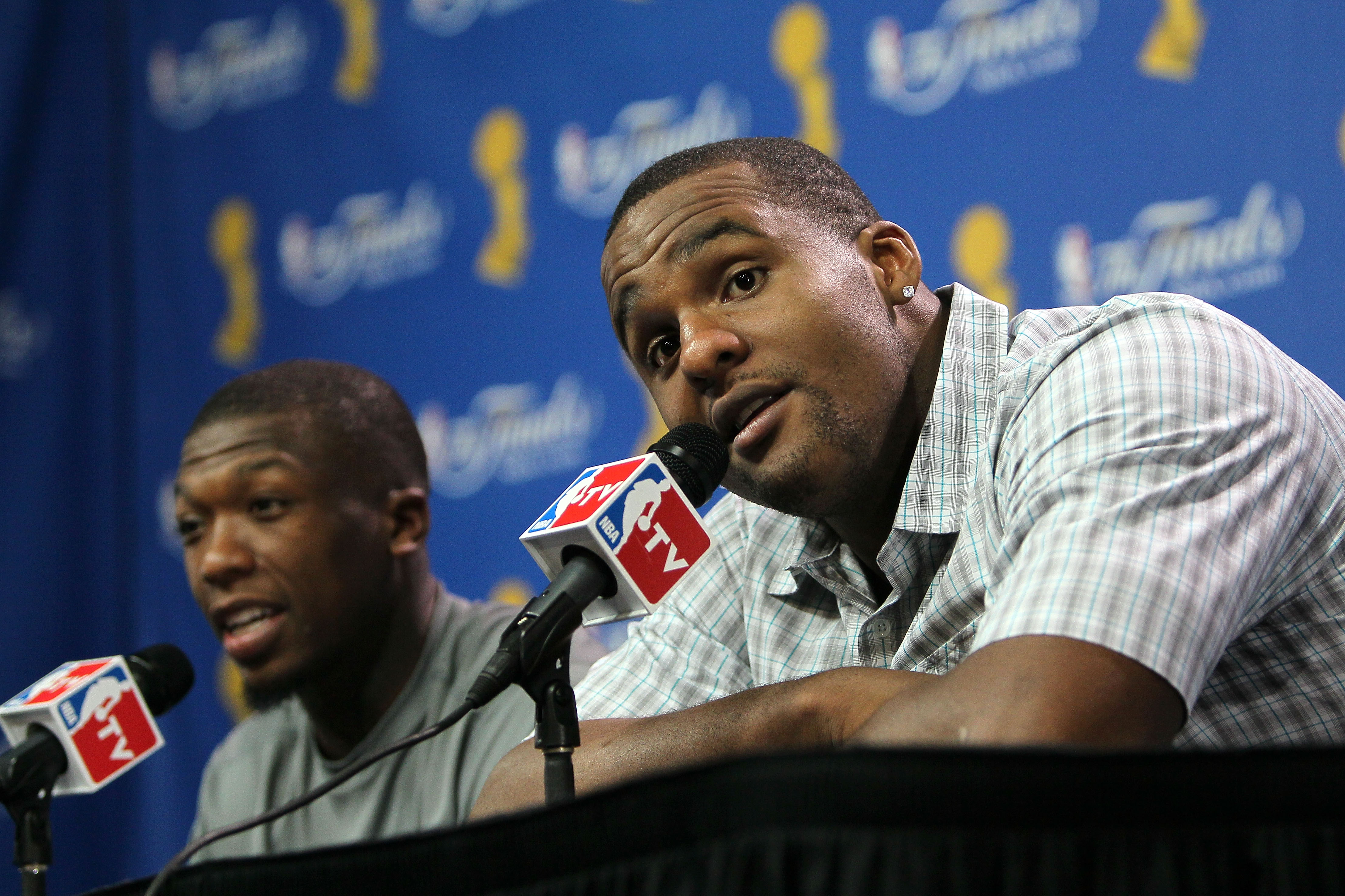 BOSTON - JUNE 10:  Nate Robinson #4 and Glen Davis #11 of the Boston Celtics speak to the media after the Celtics defeated the Los Angeles Lakers during Game Four of the 2010 NBA Finals on June 10, 2010 at TD Garden in Boston, Massachusetts. NOTE TO USER: