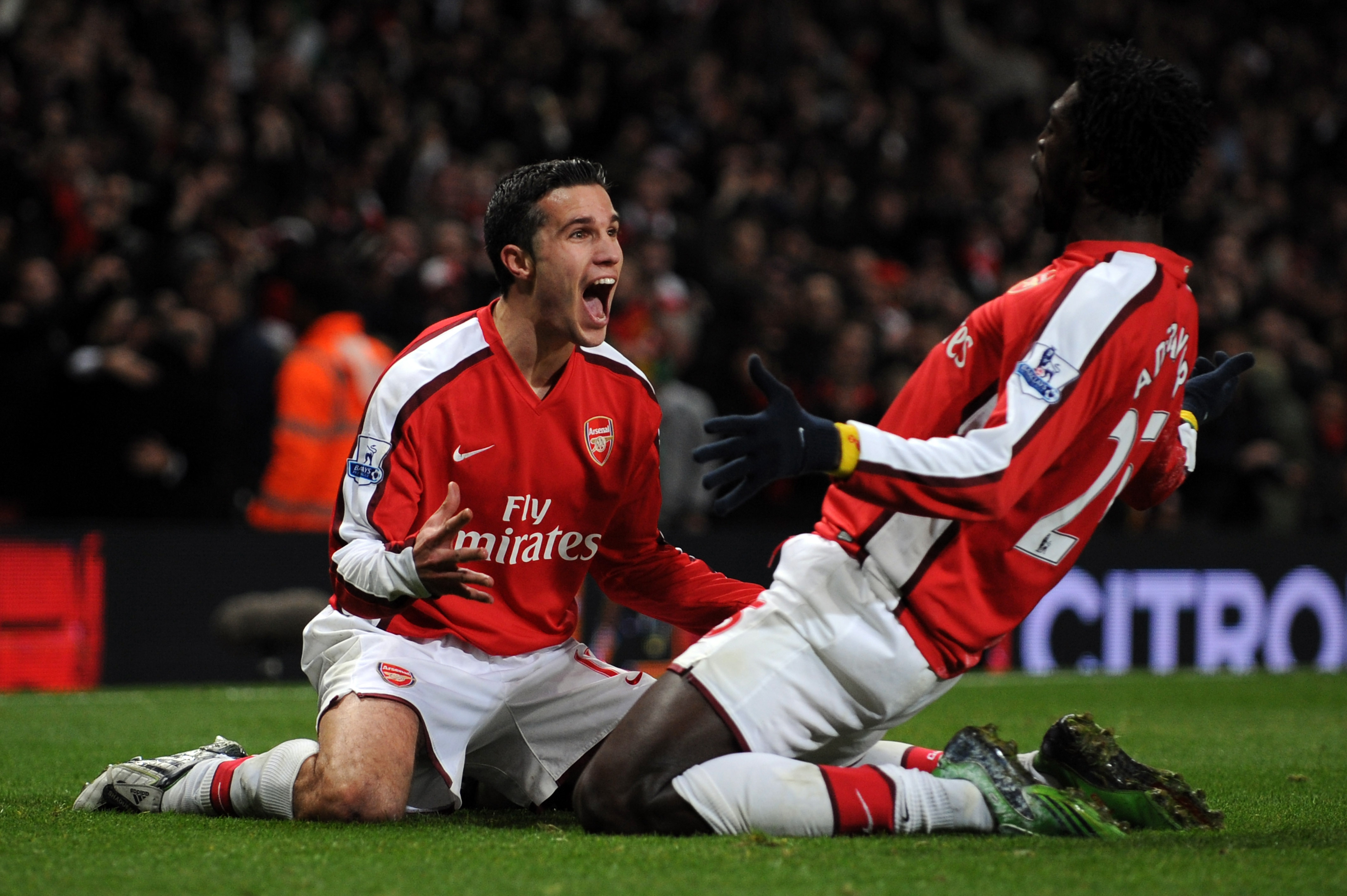 LONDON - OCTOBER 29:Robin Van Persie of Arsenal celebrates with hs team mate Emmanuel Adebayor of Arsenal after Van Persie scored during the Barclays Premier League match between Arsenal and Tottenham Hotspur at the Emirates Stadium on October 29, 2008 in