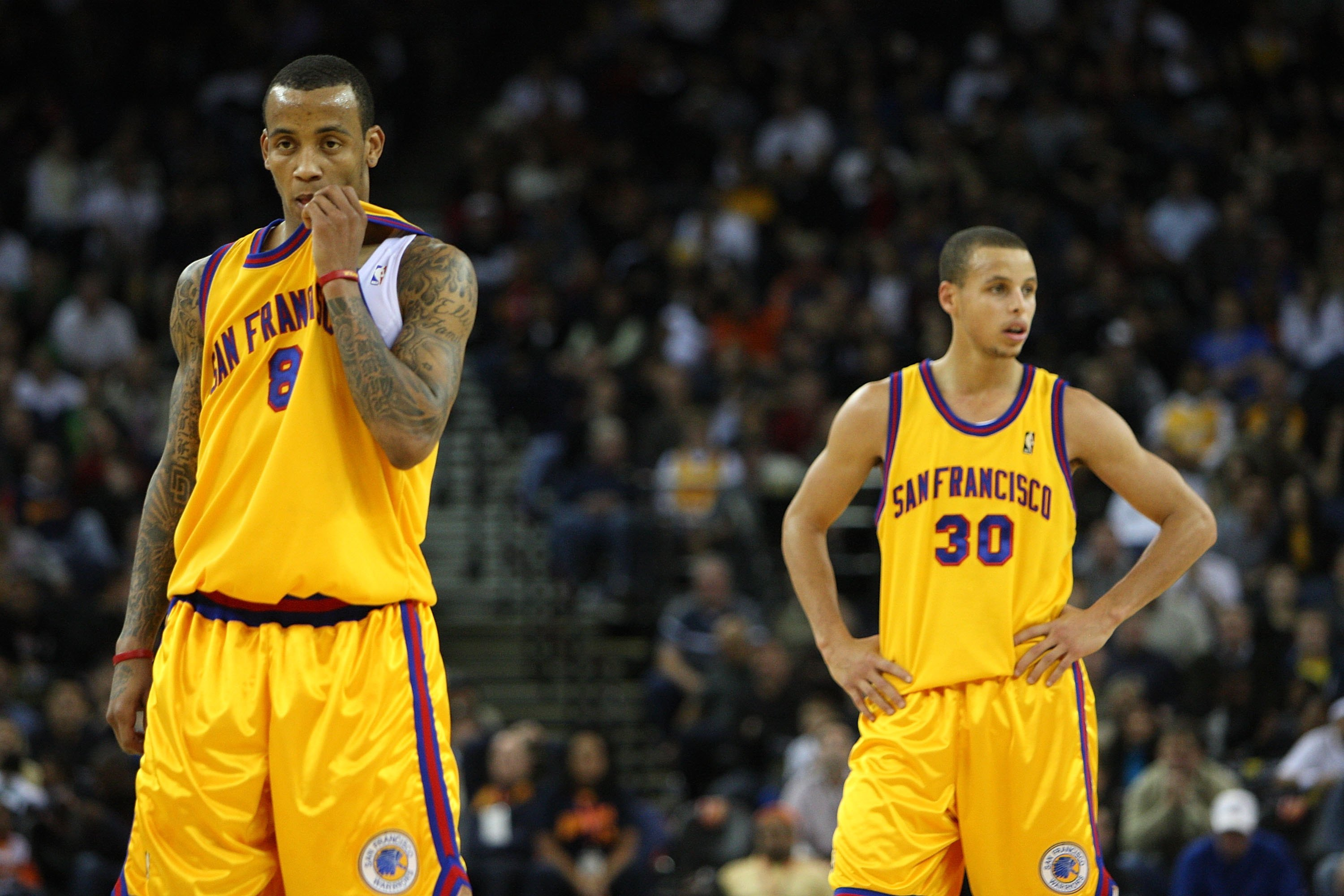 OAKLAND, CA - DECEMBER 03:  Stephen Curry #30 and Monta Ellis #8 of the Golden State Warriors look on near the end of the game against the Houston Rockets during an NBA game at Oracle Arena on December 3, 2009 in Oakland, California. NOTE TO USER: User ex