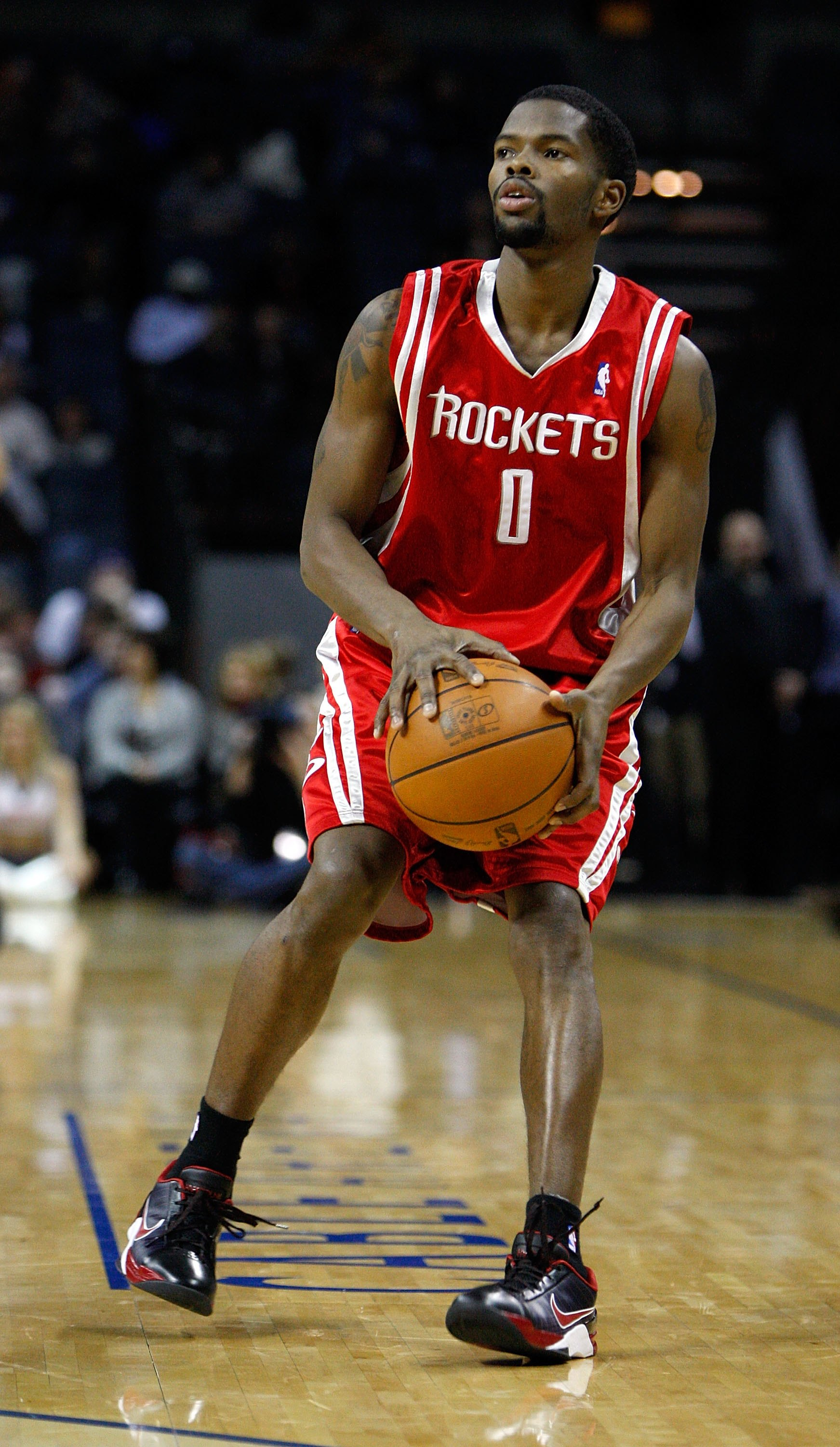 CHARLOTTE, NC - JANUARY 12:  Aaron Brooks #0 of the Houston Rockets shoots during the game against the Charlotte Bobcats on January 12, 2010 at Time Warner Cable Arena in Charlotte, North Carolina.  The Bobcats won 102-94.  NOTE TO USER: User expressly ac