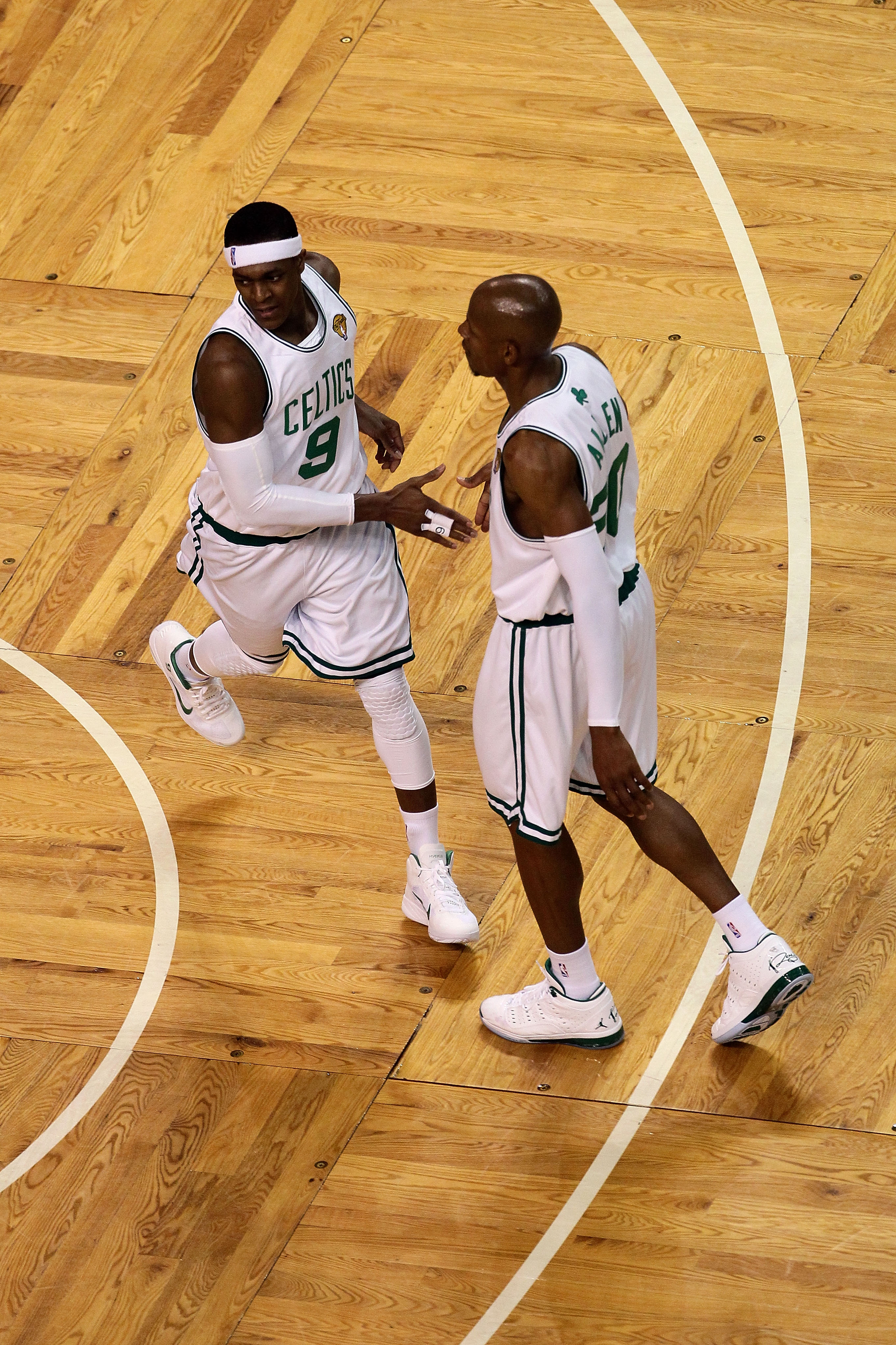 BOSTON - JUNE 10:  (L-R) Rajon Rondo #9 and Ray Allen #20 of the Boston Celltics celebrate a play against the Los Angeles Lakers during Game Four of the 2010 NBA Finals on June 10, 2010 at TD Garden in Boston, Massachusetts. NOTE TO USER: User expressly a