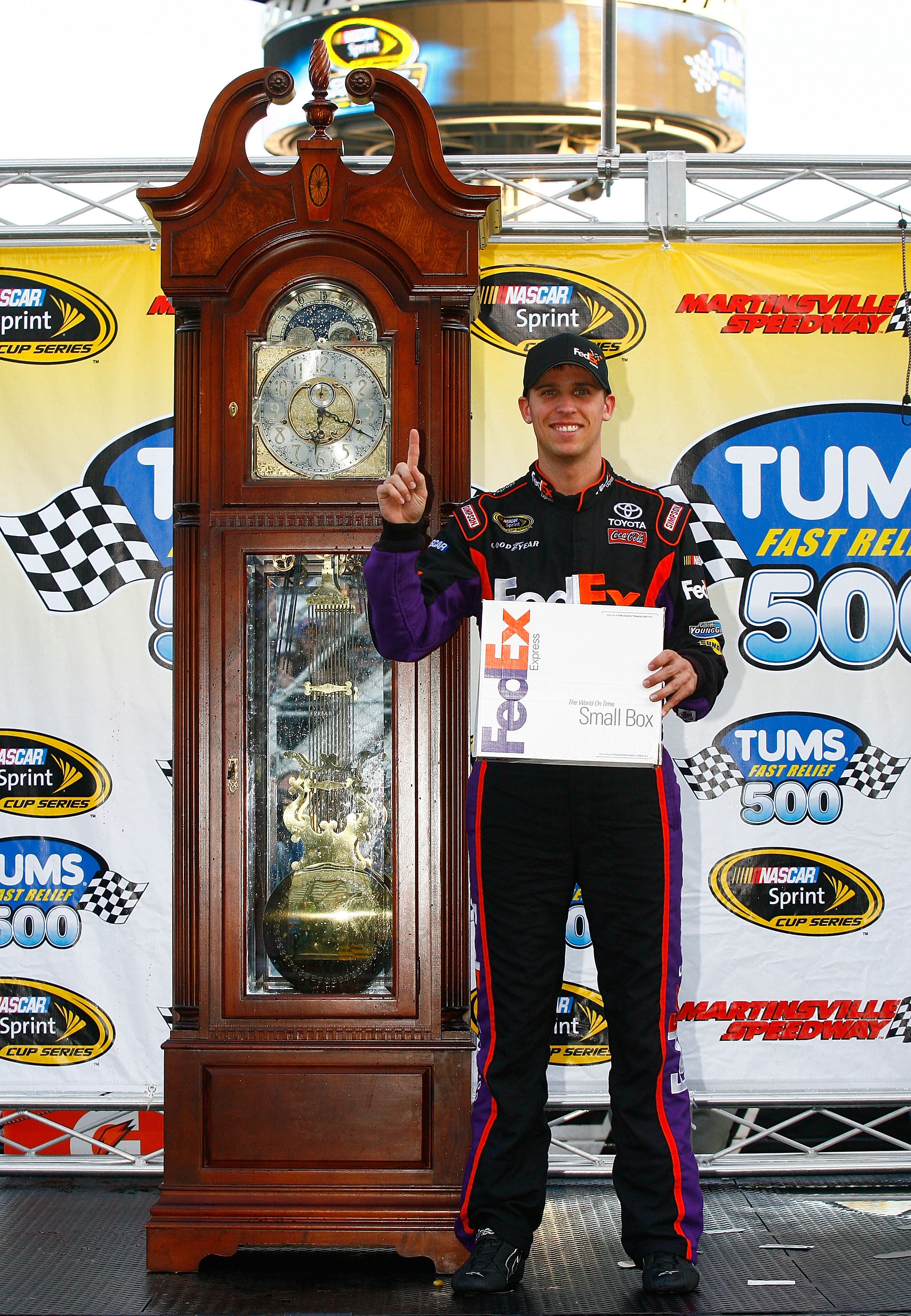MARTINSVILLE, VA - OCTOBER 24:  Denny Hamlin, driver of the #11 FedEx Express Toyota, poses in Victory Lane after winning the NASCAR Sprint Cup Series TUMS Fast Relief 500 at Martinsville Speedway on October 24, 2010 in Martinsville, Virginia.  (Photo by