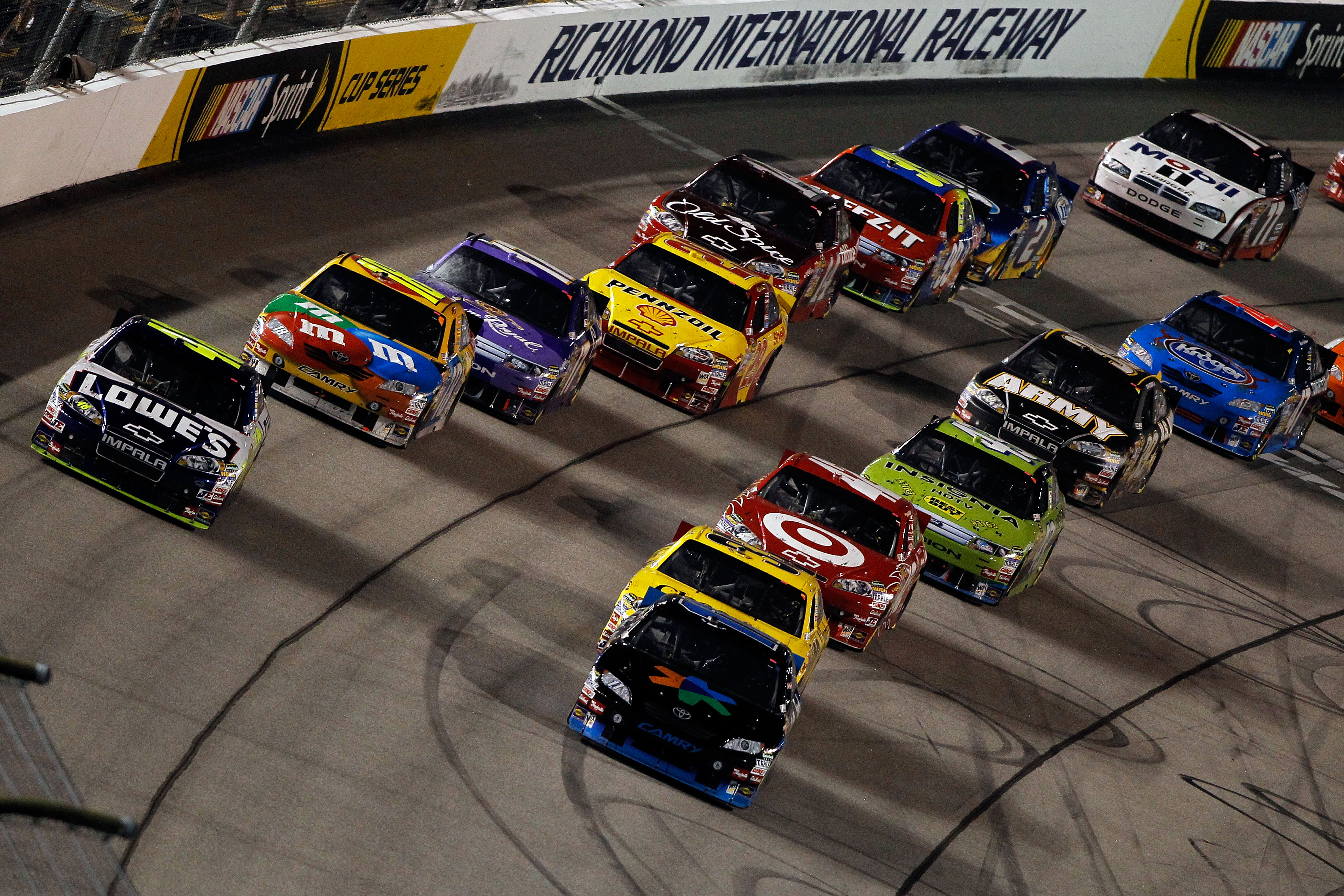 RICHMOND, VA - SEPTEMBER 11:  Jimmie Johnson, driver of the #48 Lowe's Chevrolet,  and Denny Hamlin, driver of the #11 FedEx Office Toyota, lead the field to a restart in the NASCAR Sprint Cup Series Air Guard 400 at Richmond International Raceway on Sept