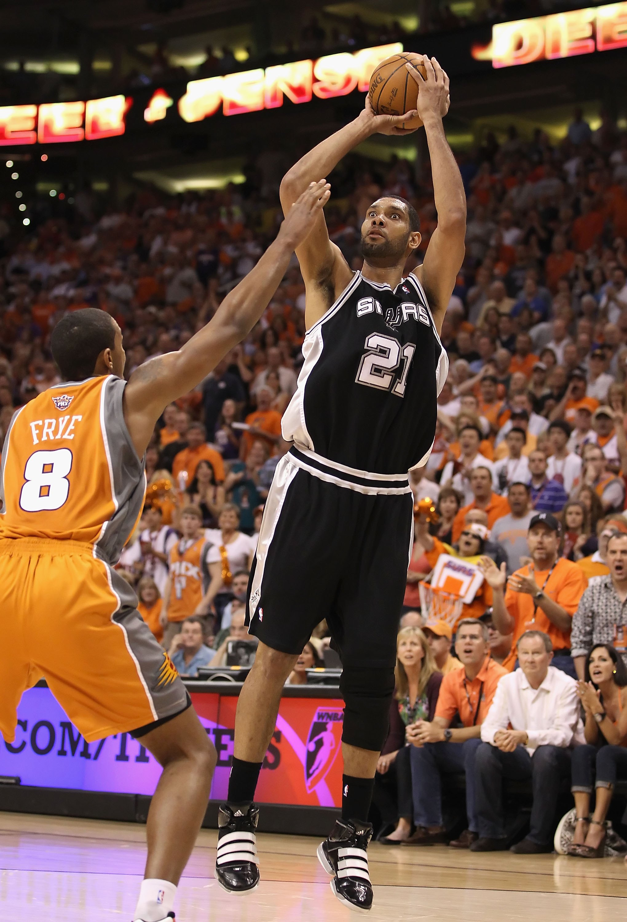 PHOENIX - MAY 05:  Tim Duncan #21 of the San Antonio Spurs shoots the ball during Game Two of the Western Conference Semifinals of the 2010 NBA Playoffs against the Phoenix Suns at US Airways Center on May 5, 2010 in Phoenix, Arizona. The team is wearing