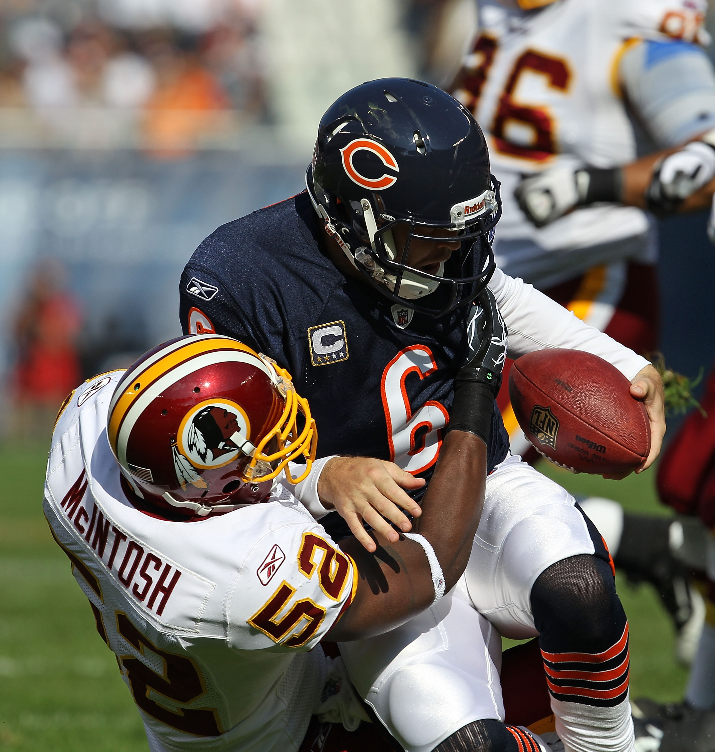 CHICAGO - OCTOBER 24: Jay Cutler #6 of the Chicago Bears is sacked by Rocky McIntosh #52 of the Washington Redskins at Soldier Field on October 24, 2010 in Chicago, Illinois. (Photo by Jonathan Daniel/Getty Images)