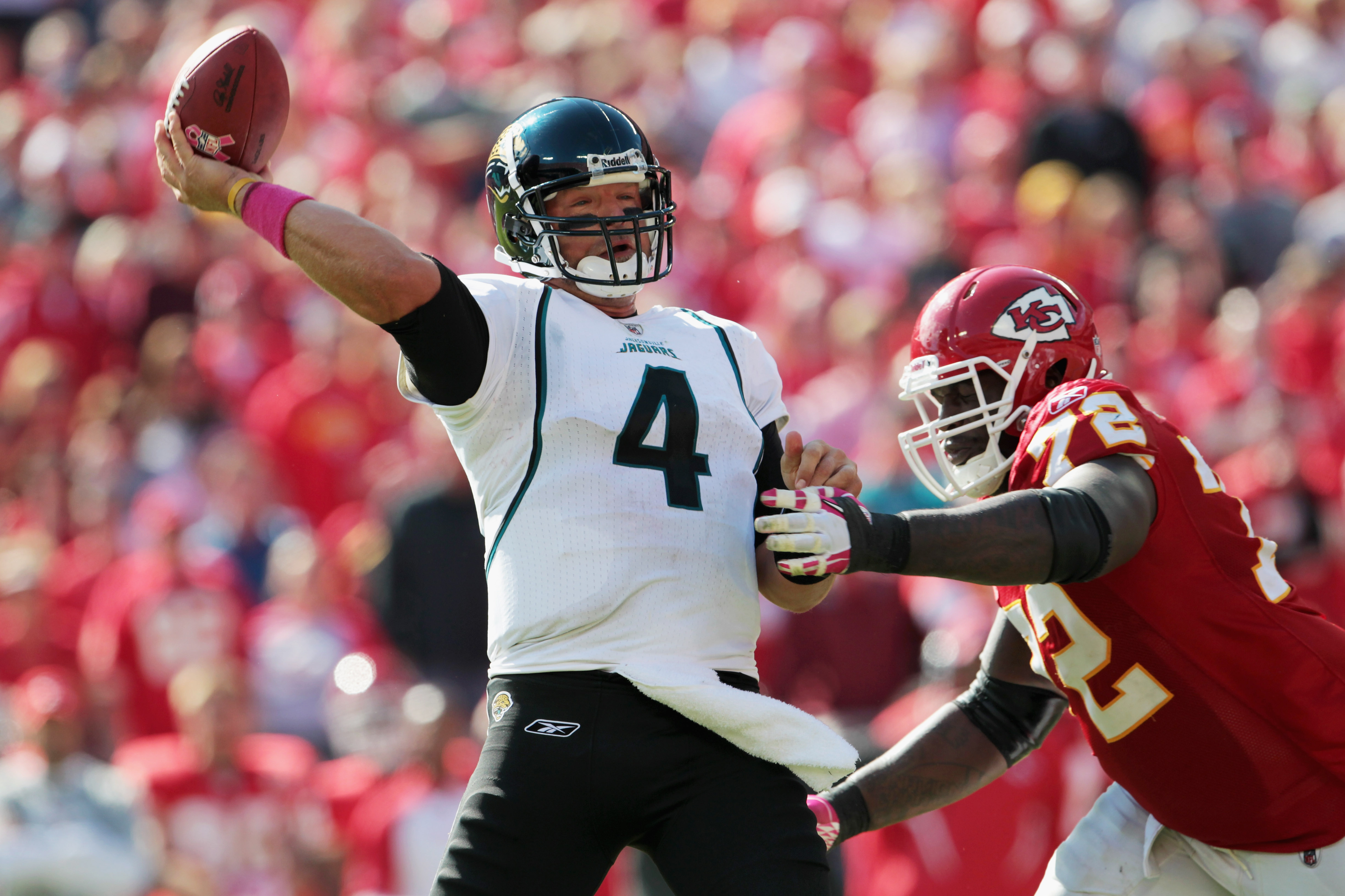 KANSAS CITY, MO - OCTOBER 24:  Quarterback Todd Bouman #4 of the Jacksonville Jaguars passes as Glenn Dorsey #72 of the Kansas City Chiefs defends during the game on October 24, 2010 at Arrowhead Stadium in Kansas City, Missouri.  (Photo by Jamie Squire/G