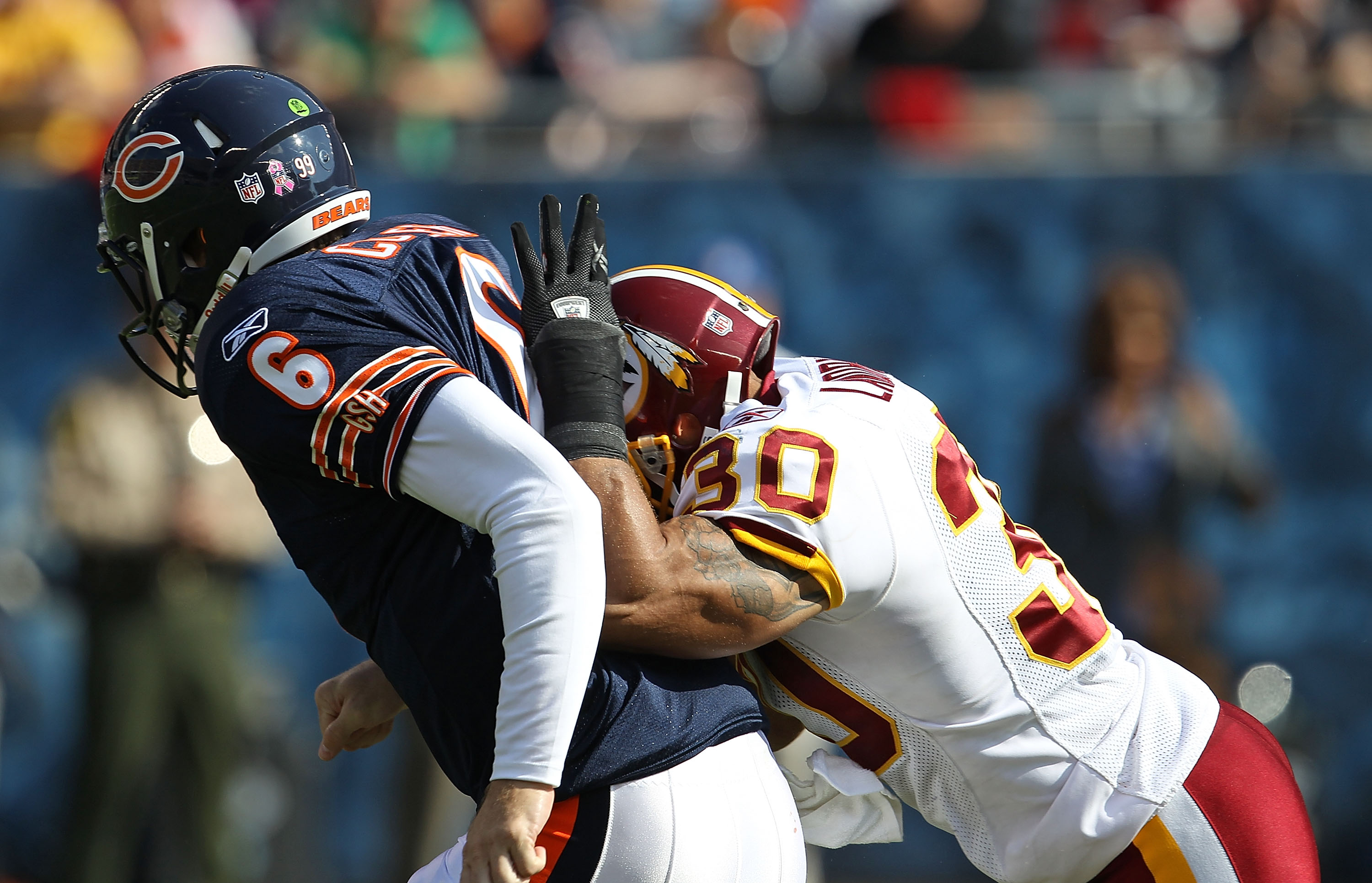 CHICAGO - OCTOBER 24: Jay Cutler #6 of the Chicago Bears is hit in the back by LaRon Landry #30 of the Washington Redskins after passing at Soldier Field on October 24, 2010 in Chicago, Illinois. (Photo by Jonathan Daniel/Getty Images)