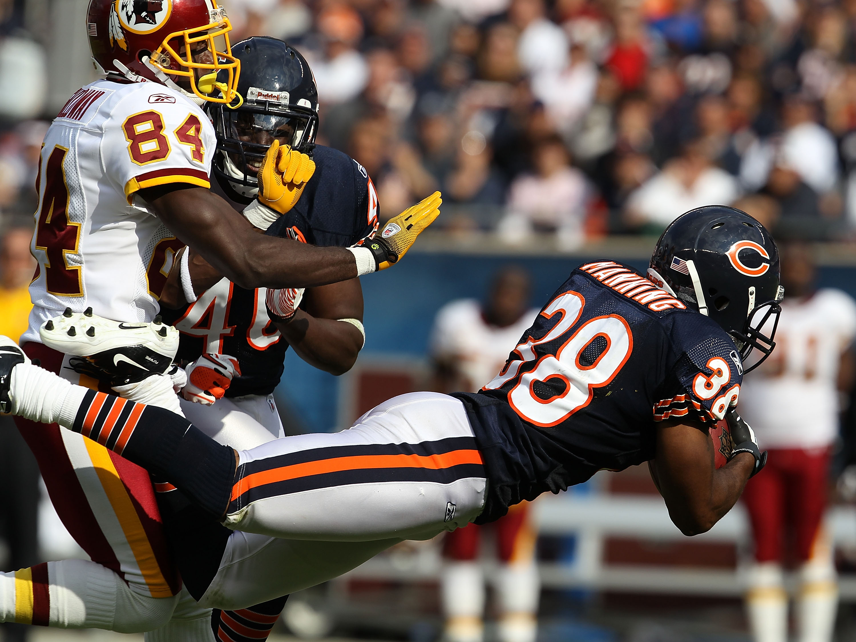 CHICAGO - OCTOBER 24: Danieal Manning #38 of the Chicago Bears intercepts a pass intended for Joey Galloway #84 of the Washington Redskins at Soldier Field on October 24, 2010 in Chicago, Illinois. The Redskins defeated the Bears 17-14. (Photo by Jonathan