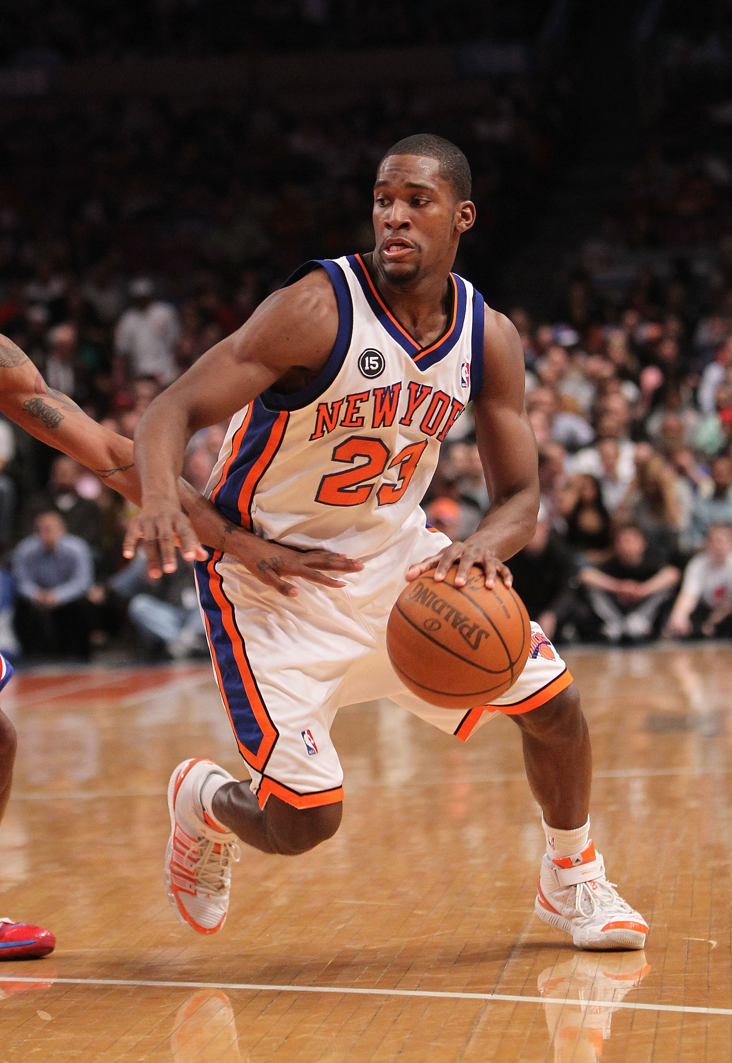 NEW YORK - MARCH 19:  Toney Douglas #23 of the New York Knicks against the Philadelphia 76ers at Madison Square Garden on March 19, 2010 in New York City. NOTE TO USER: User expressly acknowledges and agrees that, by downloading and or using this photogra