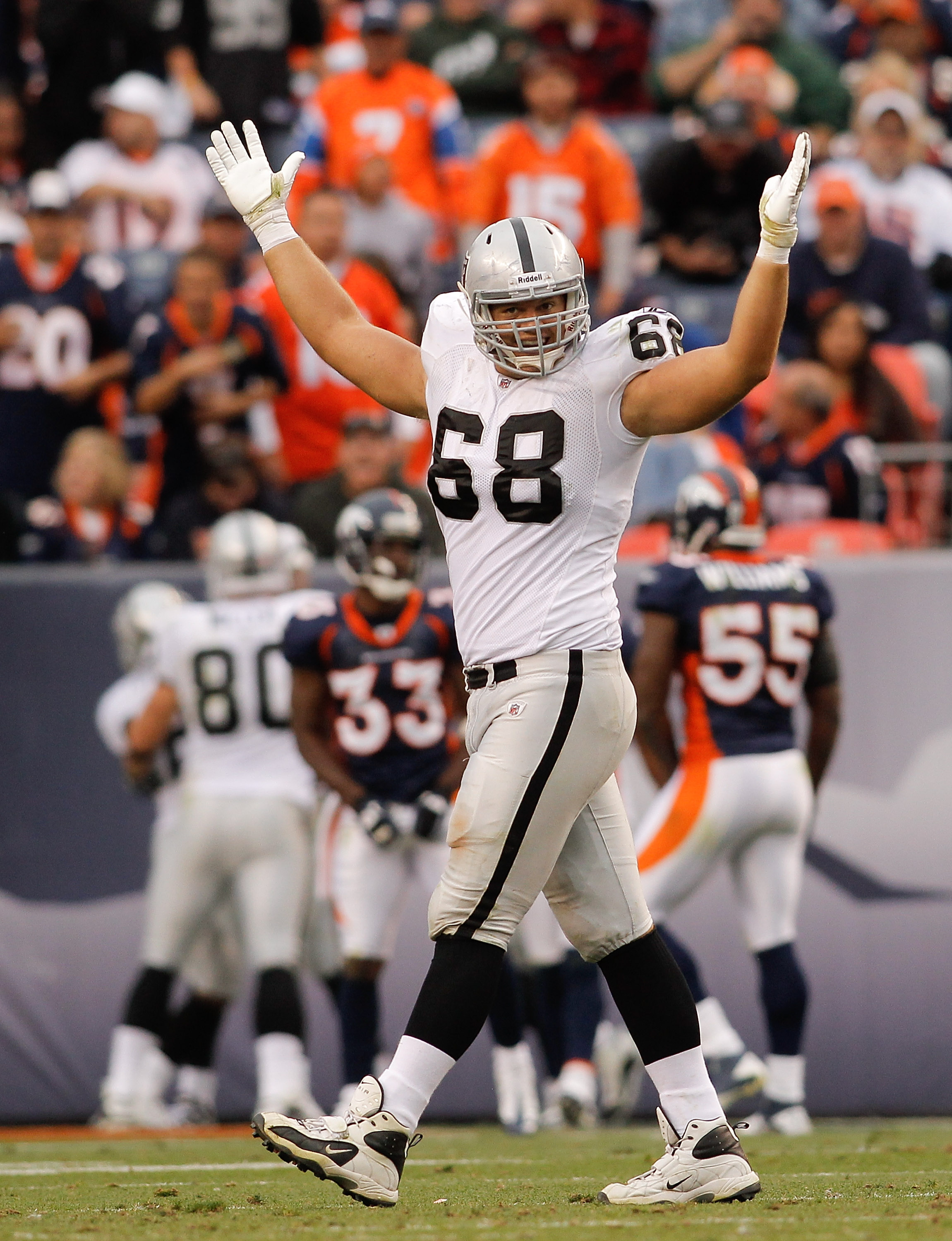DENVER - OCTOBER 24:  Center Jared Veldheer #68 of the Oakland Raiders celebrates a touchdown by teammate Darren McFadden (not pictured) in the third quarter against the Denver Broncos at INVESCO Field at Mile High on October 24, 2010 in Denver, Colorado.