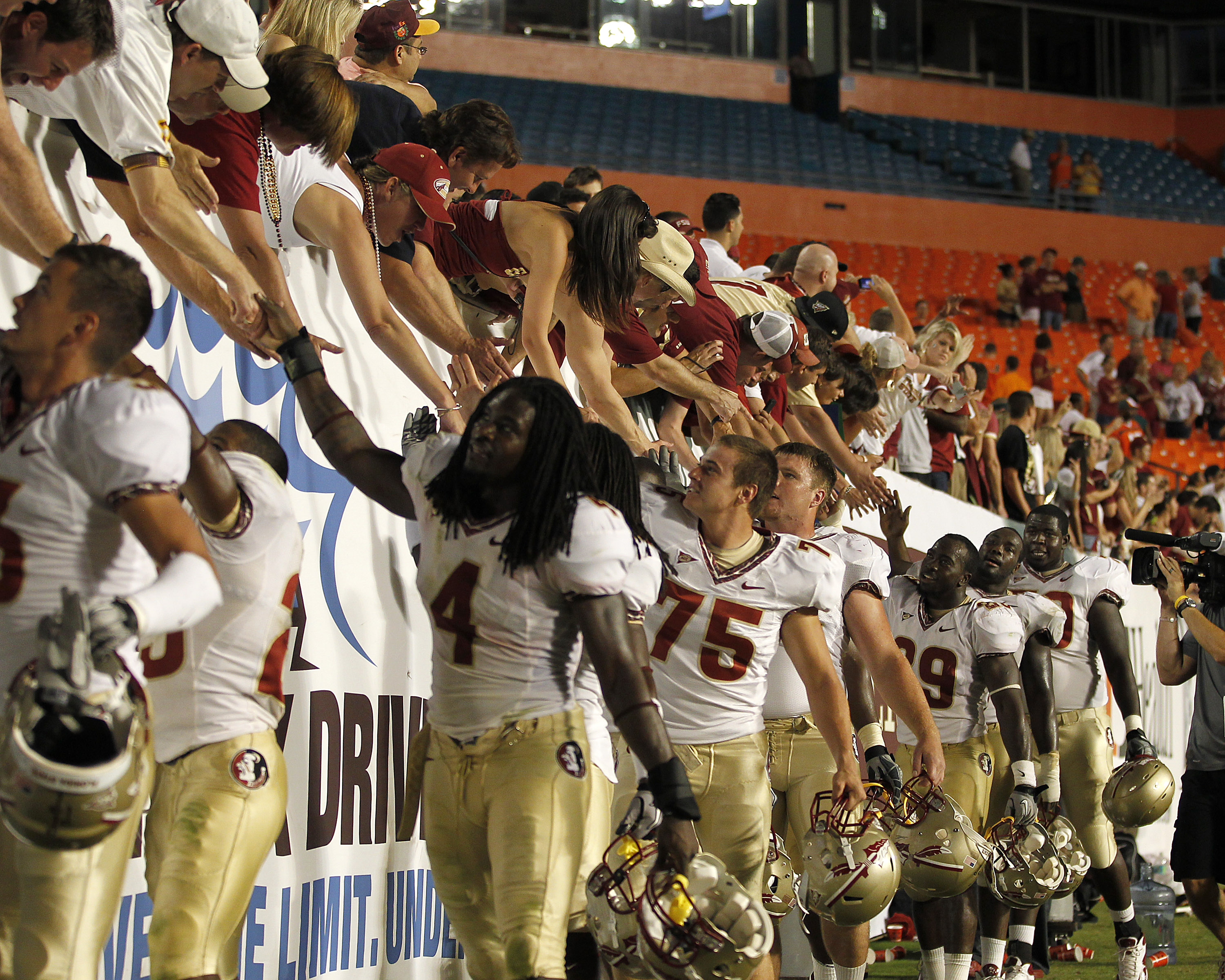 MIAMI, FL - OCTOBER 9: Florida State Seminoles fans celebrate the 45-17 victory against the Miami Hurricanes with members of the team on October 9, 2010 at Sun Life Stadium in Miami, Florida. (Photo by Joel Auerbach/Getty Images)