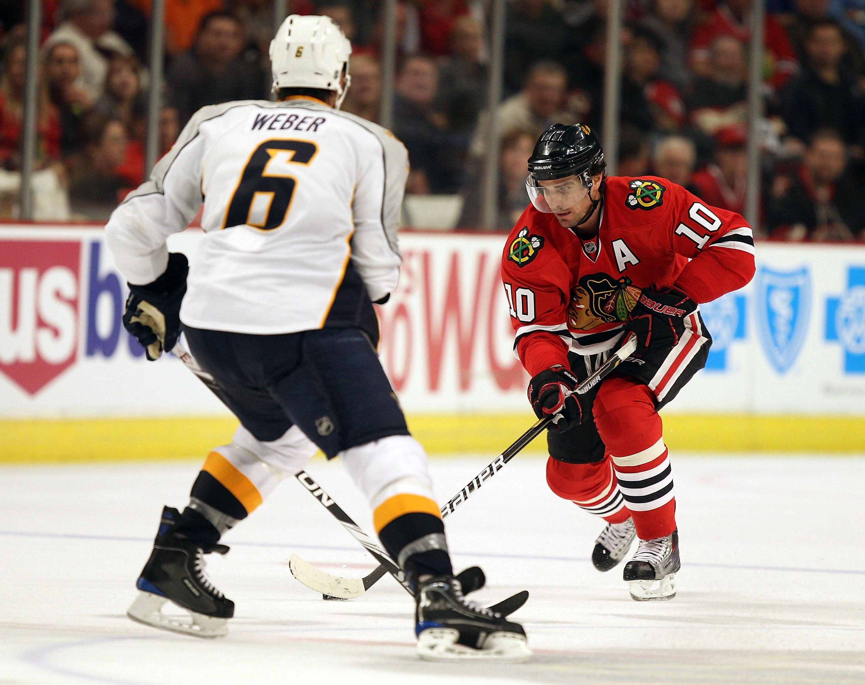 0eca978830a CHICAGO - OCTOBER 13: Patrick Sharp #10 of the Chicago Blackhawks skates up  the