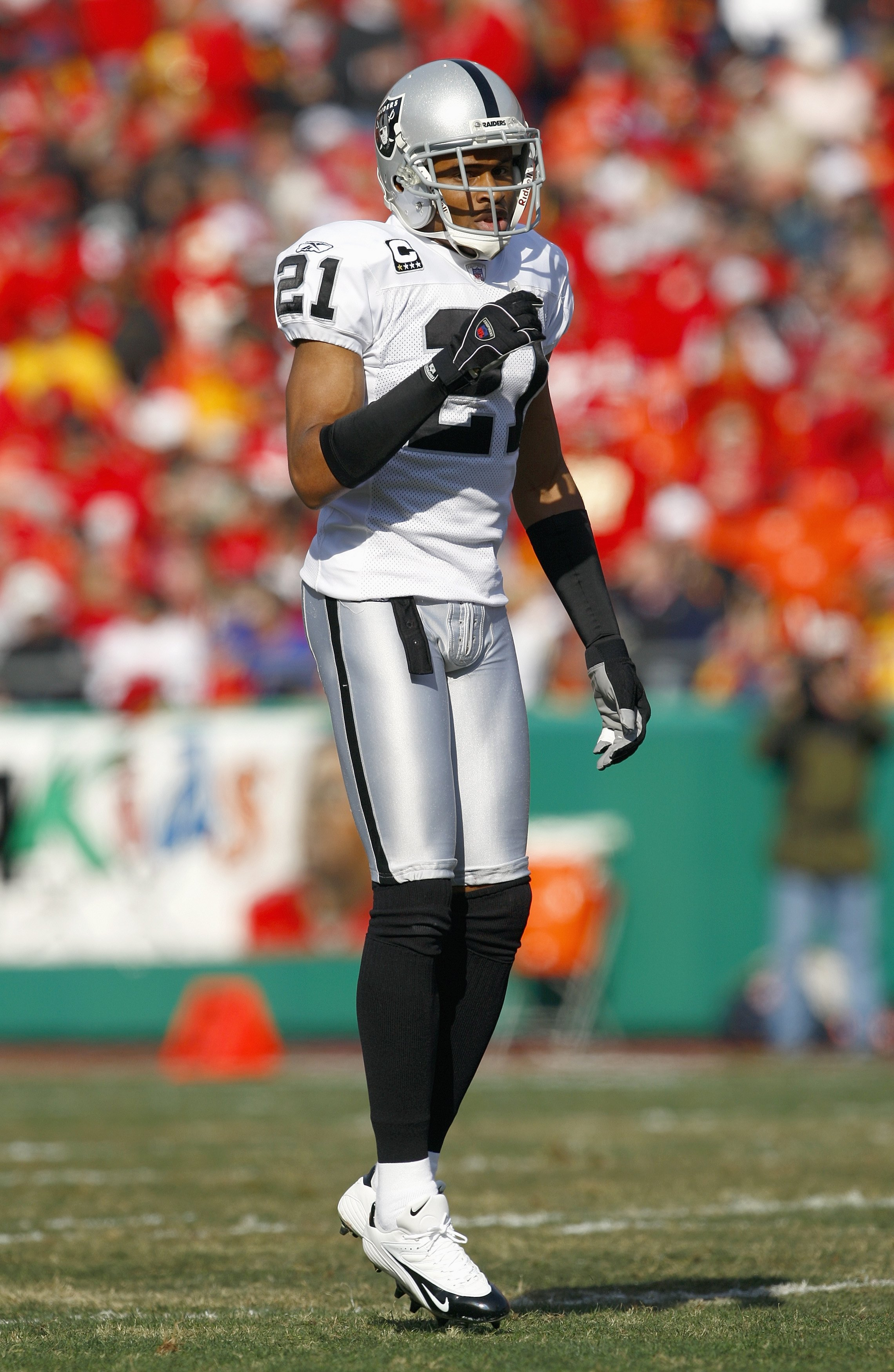 KANSAS CITY, MO - NOVEMBER 25: Nnamdi Asomugha #21of the Oakland Raiders hops on the field during the game against the Kansas City Chiefs November 25, 2007 at Arrowhead Stadium in Kansas City, Missouri. (Photo by Jamie Squire/Getty Images)