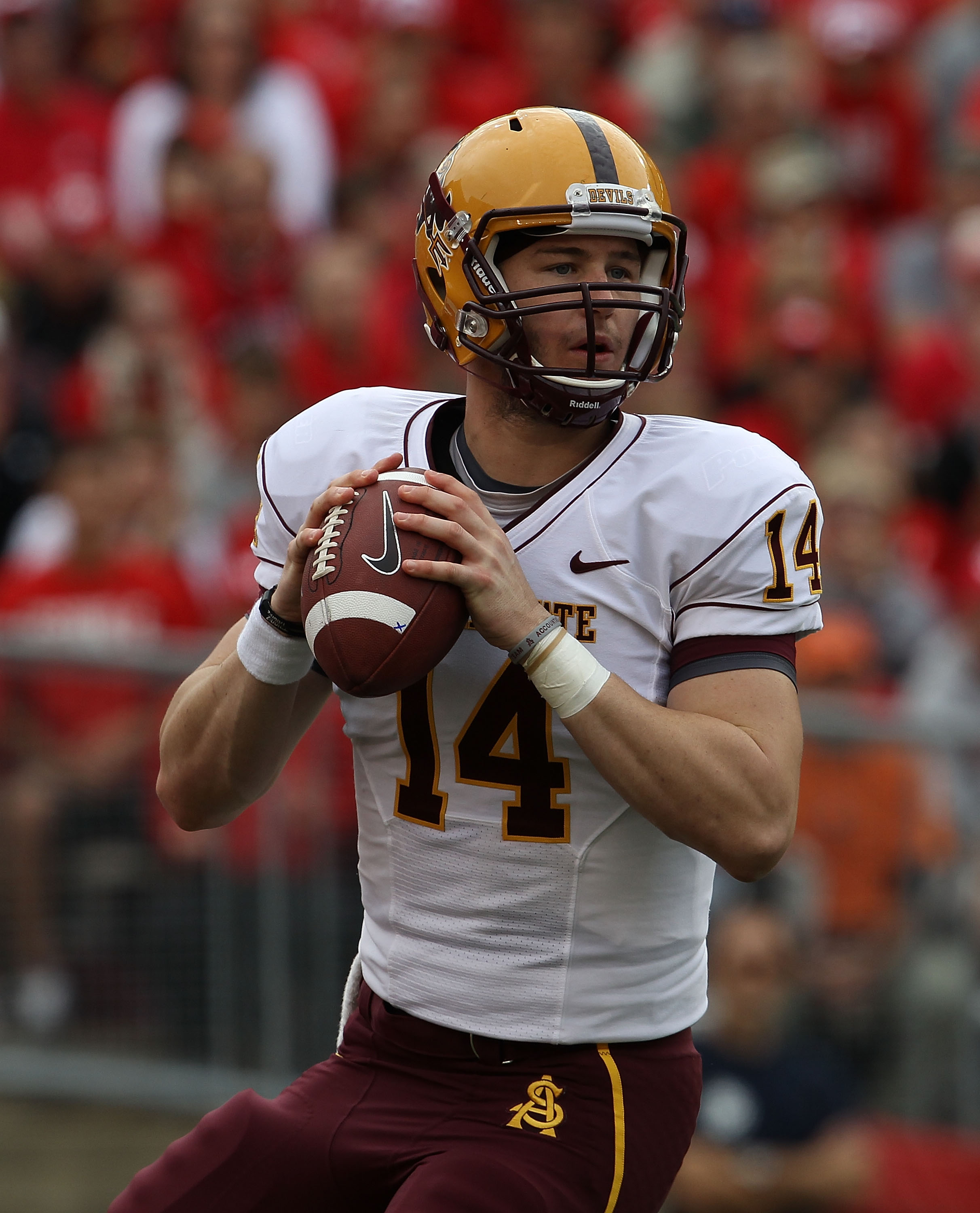 MADISON, WI - SEPTEMBER 18: Steven Threet #14 of the Arizona State Sun Devils looks for a receiver against the Wisconsin Badgers at Camp Randall Stadium on September 18, 2010 in Madison, Wisconsin. Wisconsin defeated Arizona State 20-19.  (Photo by Jonath