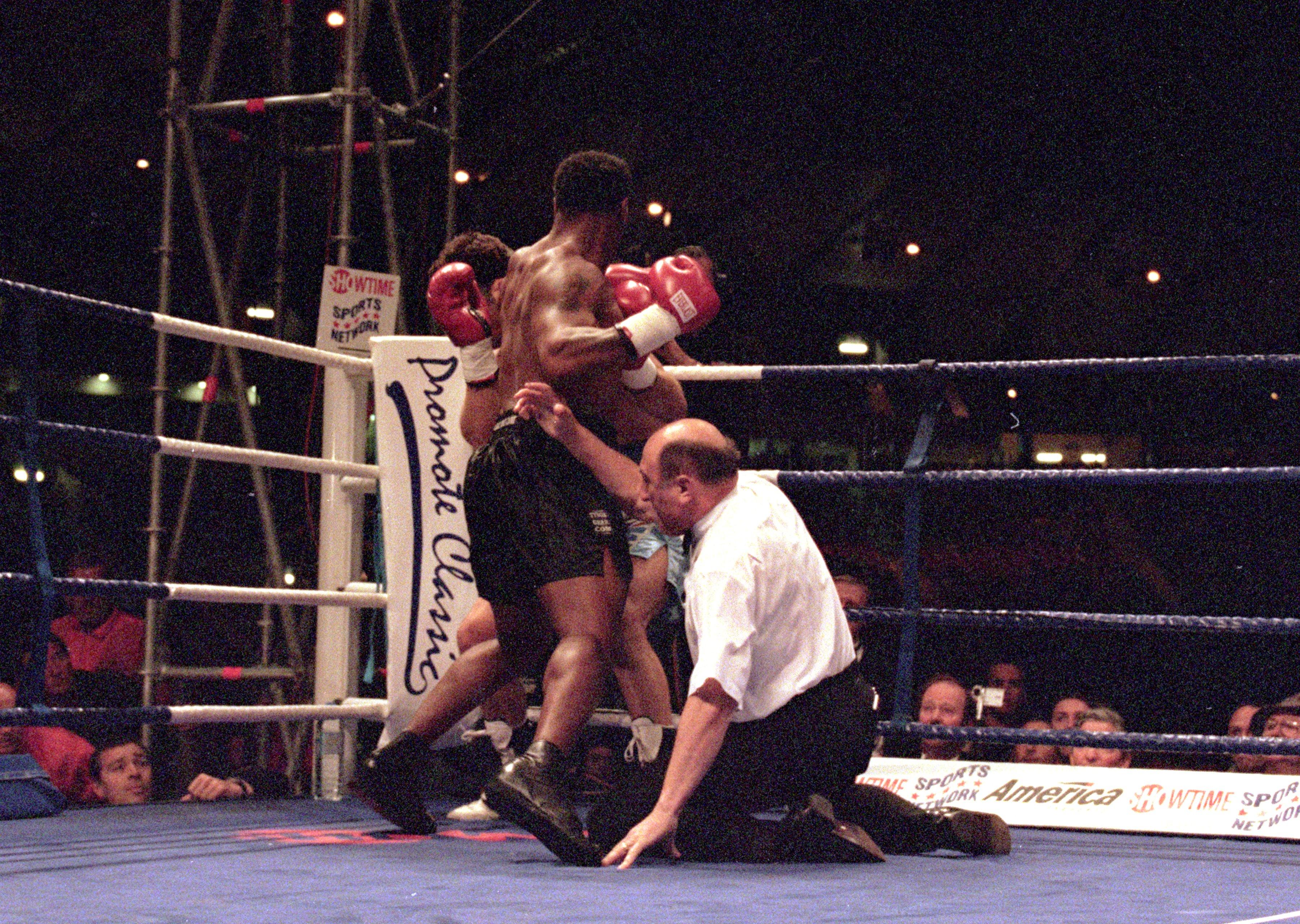 24 Jun 2000:  Mike Tyson floors the referee during the heavyweight fight against Lou Savarese at Hampden Park in Glasgow, Scotland.  Mike Tyson won when the referee stopped the fight in the first round. \ Mandatory Credit: John Gichigi /Allsport