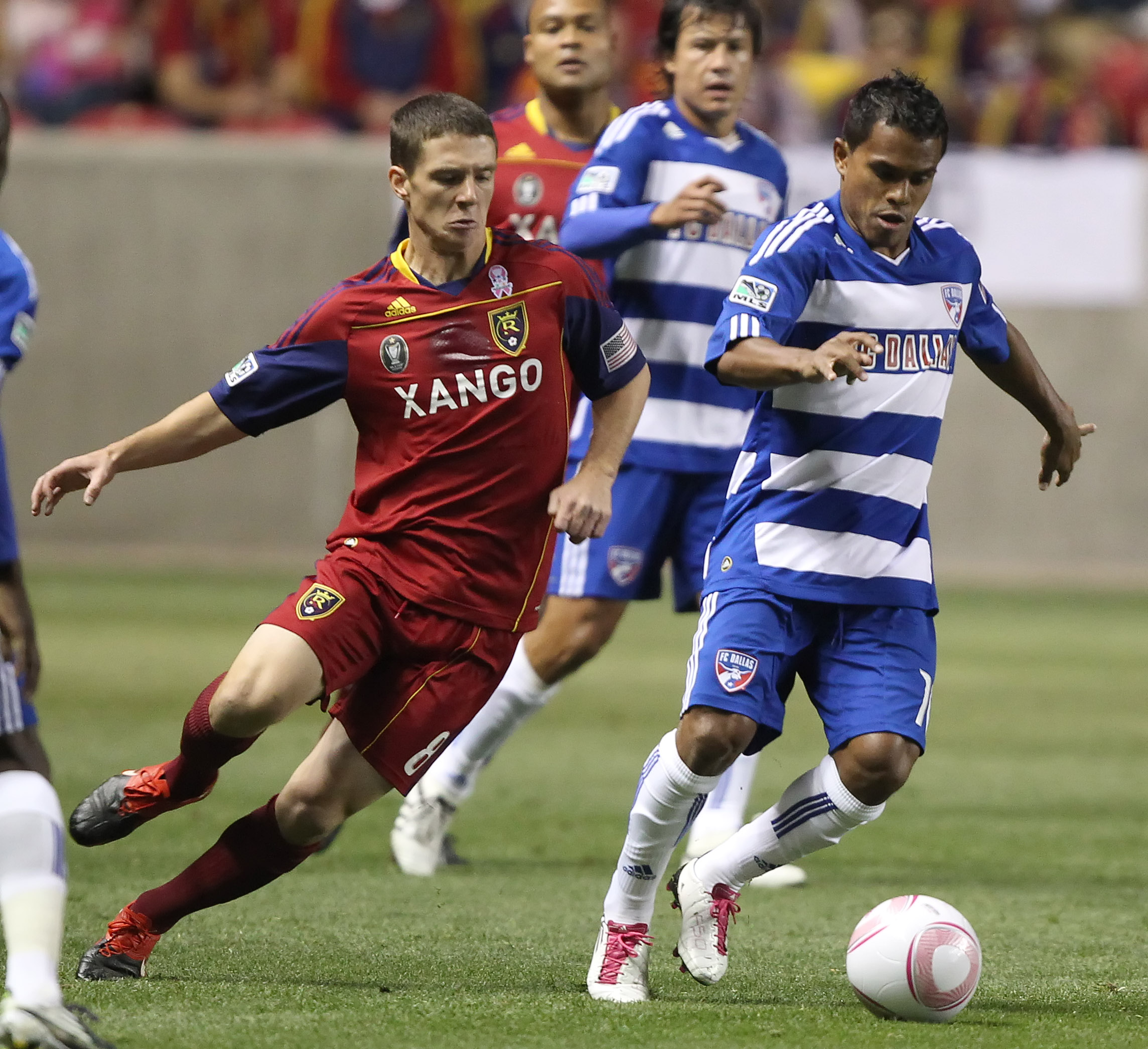 SANDY, UT - SEPTEMBER 16: Will Johnson #8 of Real Salt Lake of and David Ferreira #10 FC Dallas fight for the ball during the first half of an MLS soccer game September 16, 2010 at Rio Tinto Stadium in Sandy, Utah. (Photo by George Frey/Getty Images)