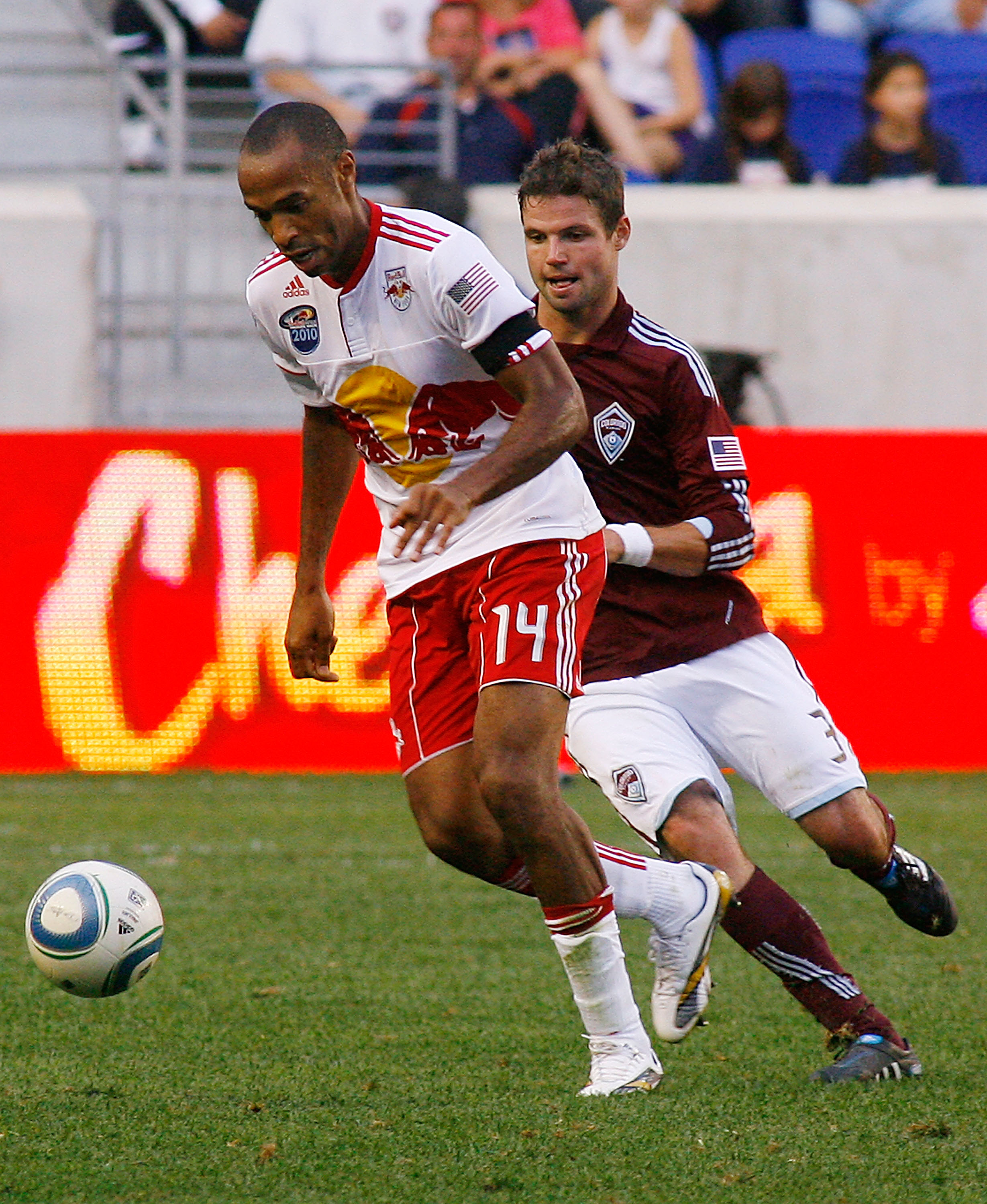 HARRISON, NJ - SEPTEMBER 11: Thierry Henry #14 of the New York Red Bulls plays the ball away from Drew Moor #3 of the Colorado Rapids during the game at Red Bull Arena on September 11, 2010 in Harrison, New Jersey. (Photo by Andy Marlin/Getty Images )