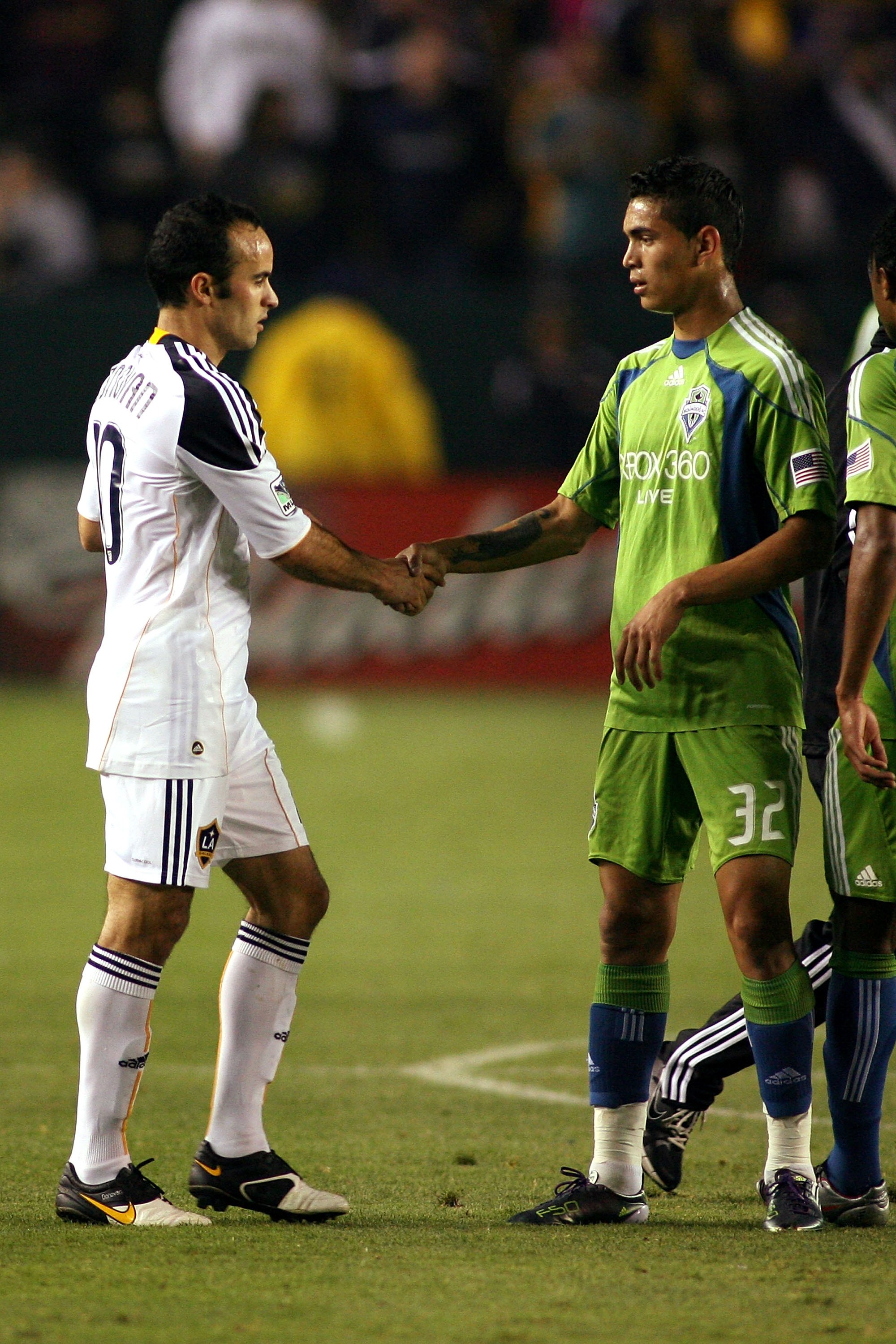 CARSON, CA - JULY 04:  Landon Donovan #10 of the Los Angeles Galaxy shakes hands with Miguel Montano #32 of the Seattle Sounders FC after the game on July 4, 2010 at the Home Depot Center in Carson, California.  Donovan was playing in his first MLS game s