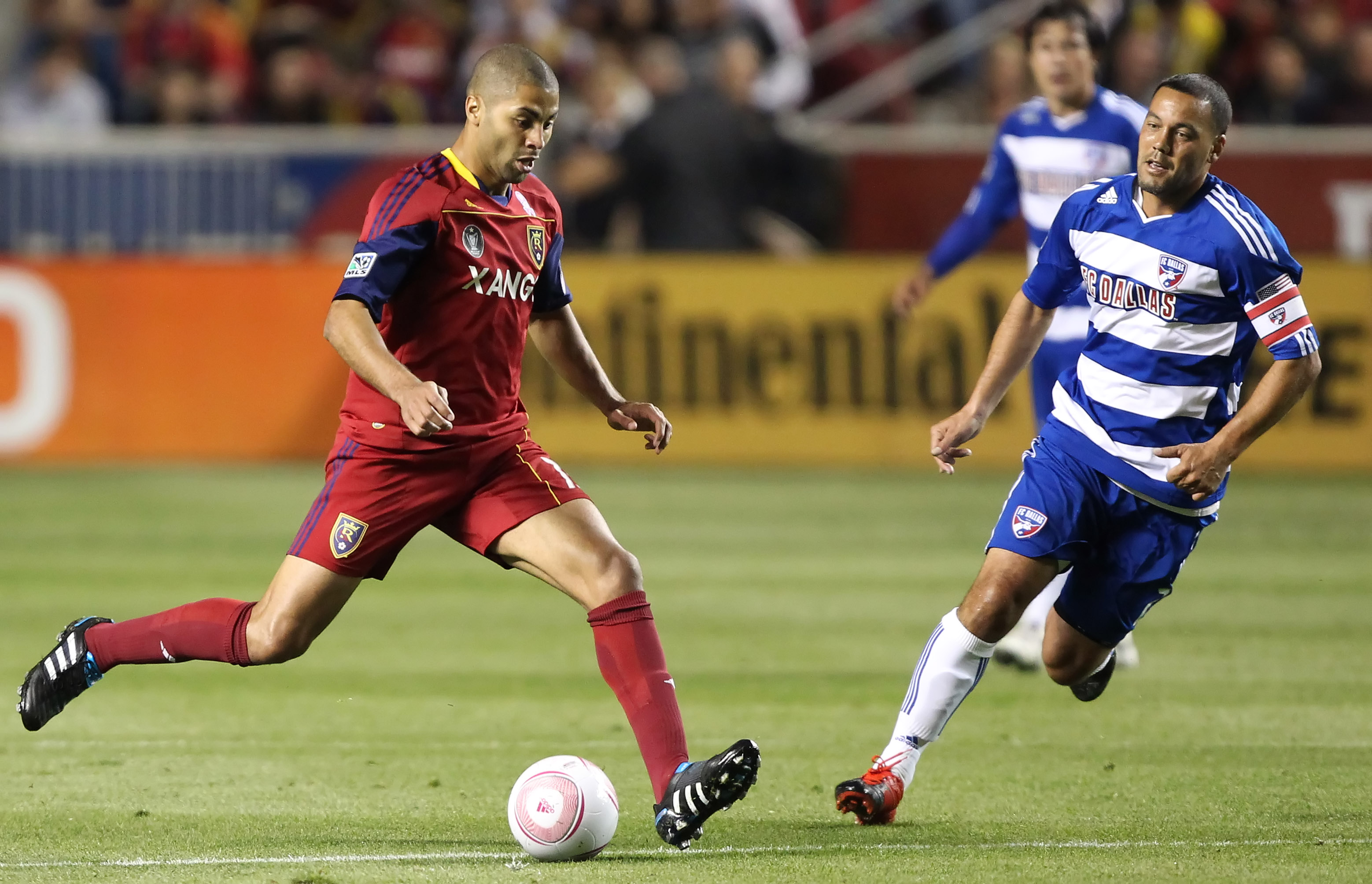 SANDY, UT - SEPTEMBER 16: Alvaro Saborio #15 of Real Salt Lake kicks the ball as Daniel Hernandez #2 of FC Dallas watches during the first half of an MLS soccer game September 16, 2010 at Rio Tinto Stadium in Sandy, Utah. (Photo by George Frey/Getty Image