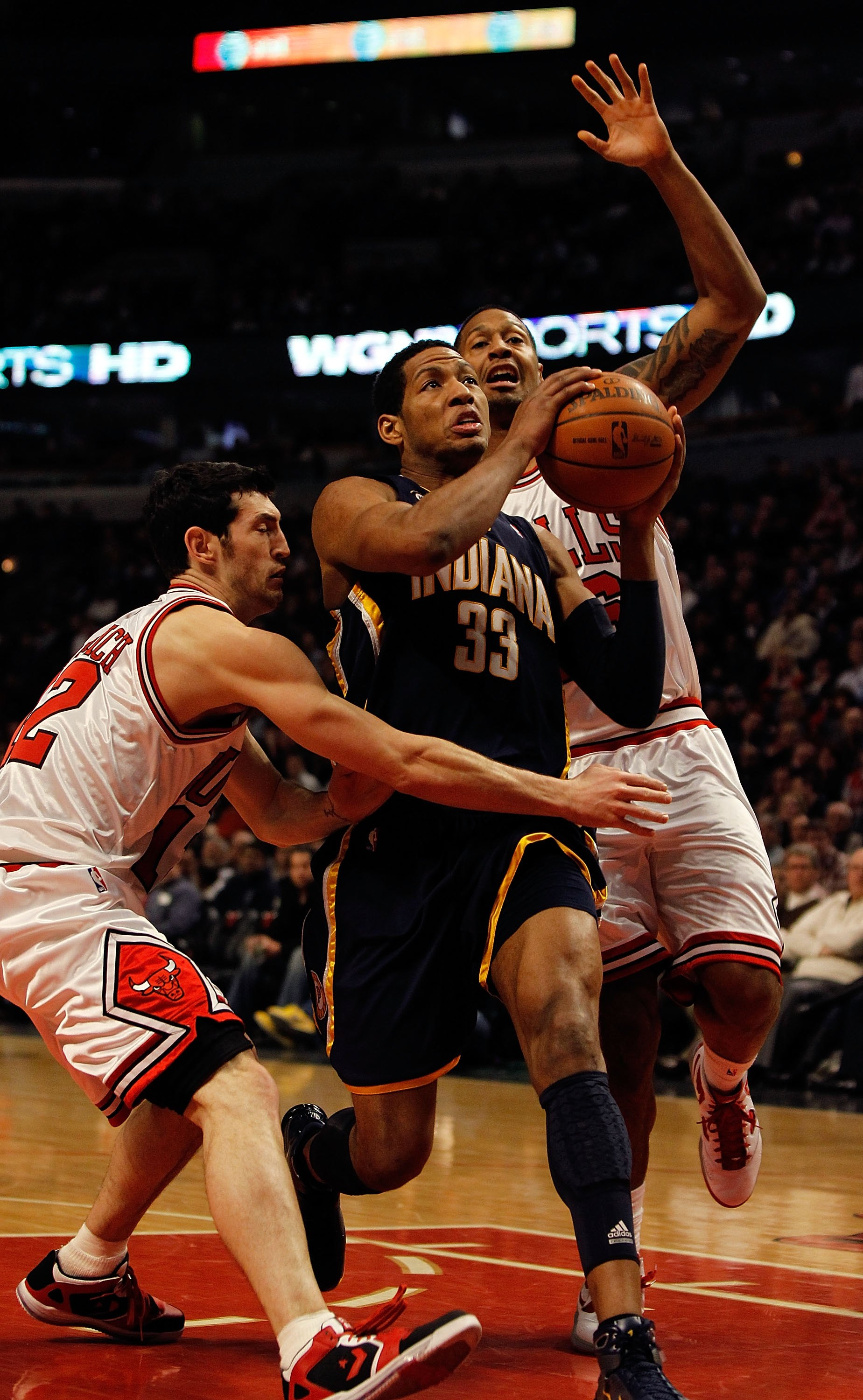 CHICAGO - FEBRUARY 24: Danny Granger #33 of the Indiana Pacers drives to the basket between Kirk Hinrich #12 and James Johnson #16 of the Chicago Bulls at the United Center on February 24, 2010 in Chicago, Illinois. The Bulls defeated the Pacers 120-110.