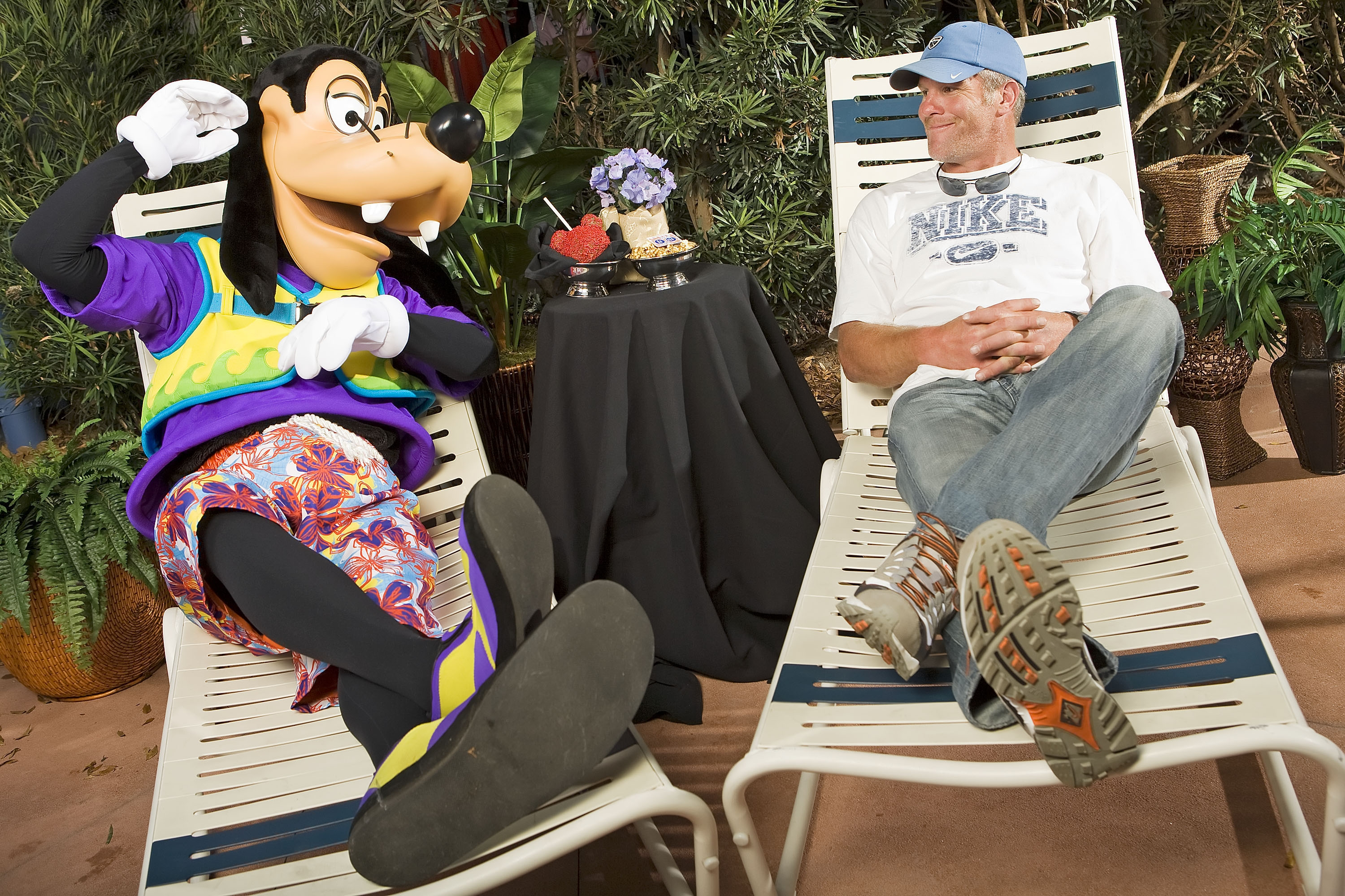 LAKE BUENA VISTA, FL - FEBRUARY 28:  In this handout photo provided by Walt Disney World, in a photo taken February 28, 2009 NFL quarterback Brett Favre lounges with Goofy at Walt Disney World Resort in Lake Buena Vista, Florida.  Favre was appearing at '