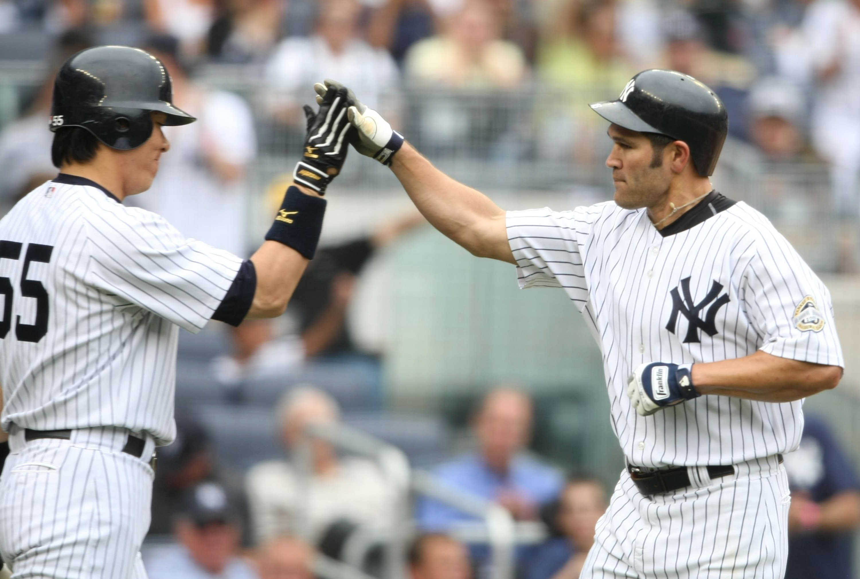 NEW YORK - AUGUST 12:  Johnny Damon #2 (R) of the New York Yankees gets a high five from teammate Hideki Matsui #55 after hitting a homerun in the third inning during the MLB game against the Toronto Blue Jays on August 12, 2009 at Yankee Stadium in the B