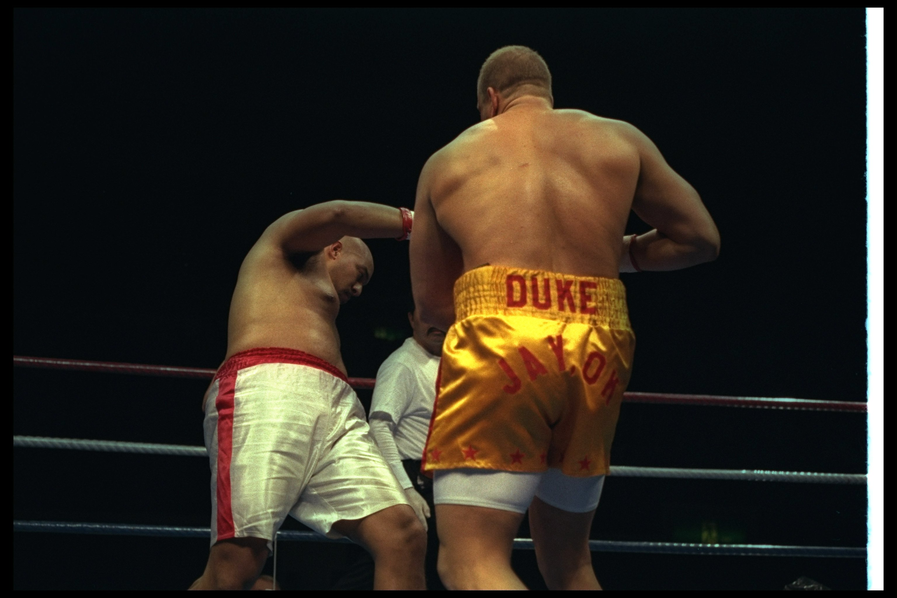 3 Nov 1996:  Tommy Morrison knocks Marcus Rhode down during a bout at Tokyo Bay NK Hall in Tokyo, Japan.  Morrison won the fight with a knockout in the first round. Mandatory Credit: Al Bello  /Allsport
