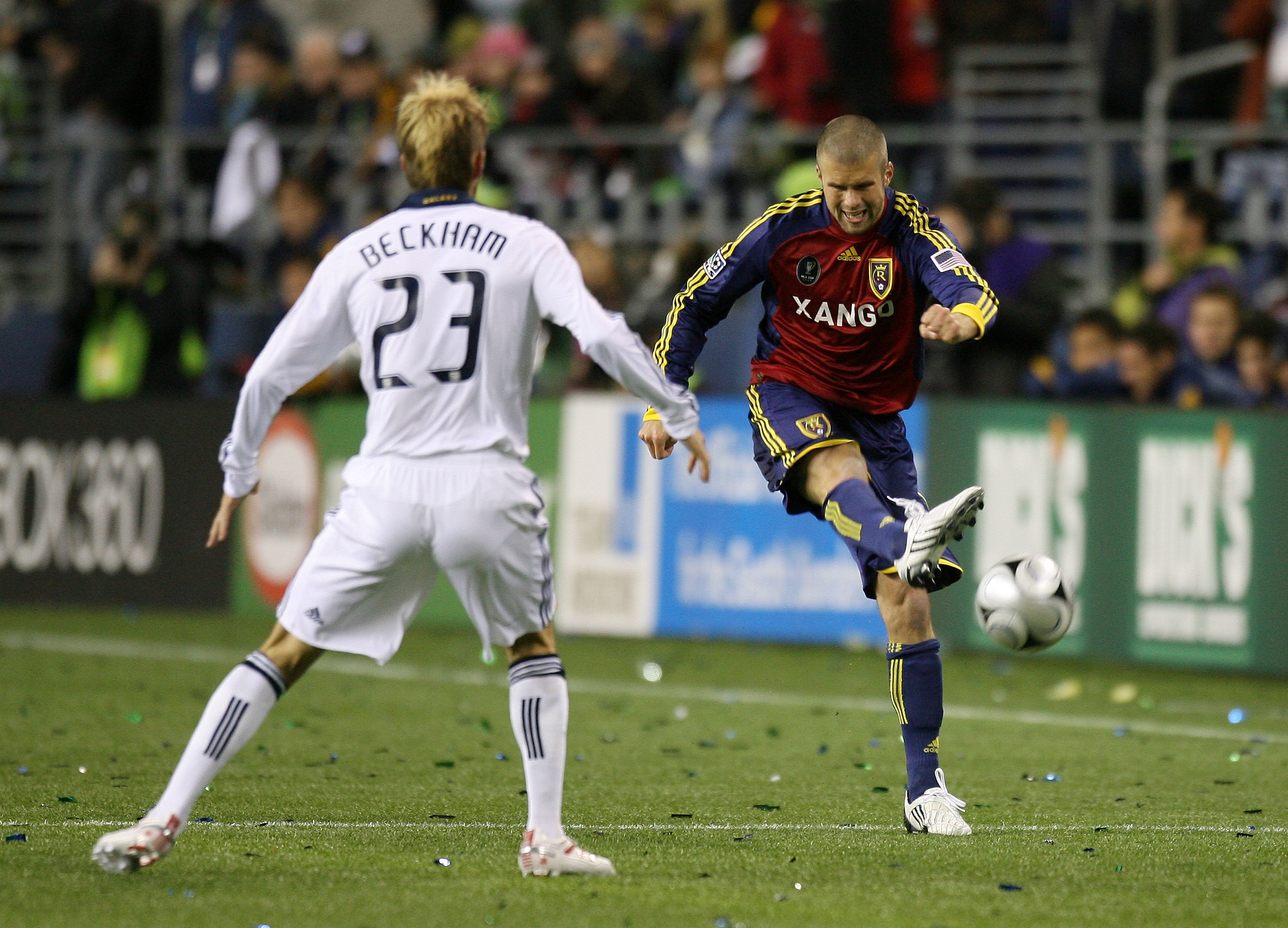 SEATTLE - NOVEMBER 22:  Chris Wingert #17 of Real Salt Lake passes the ball past David Beckham #23 of Los Angeles Galaxy during the MLS Cup final at Qwest Field on November 22, 2009 in Seattle, Washington.  (Photo by Otto Greule Jr/Getty Images)