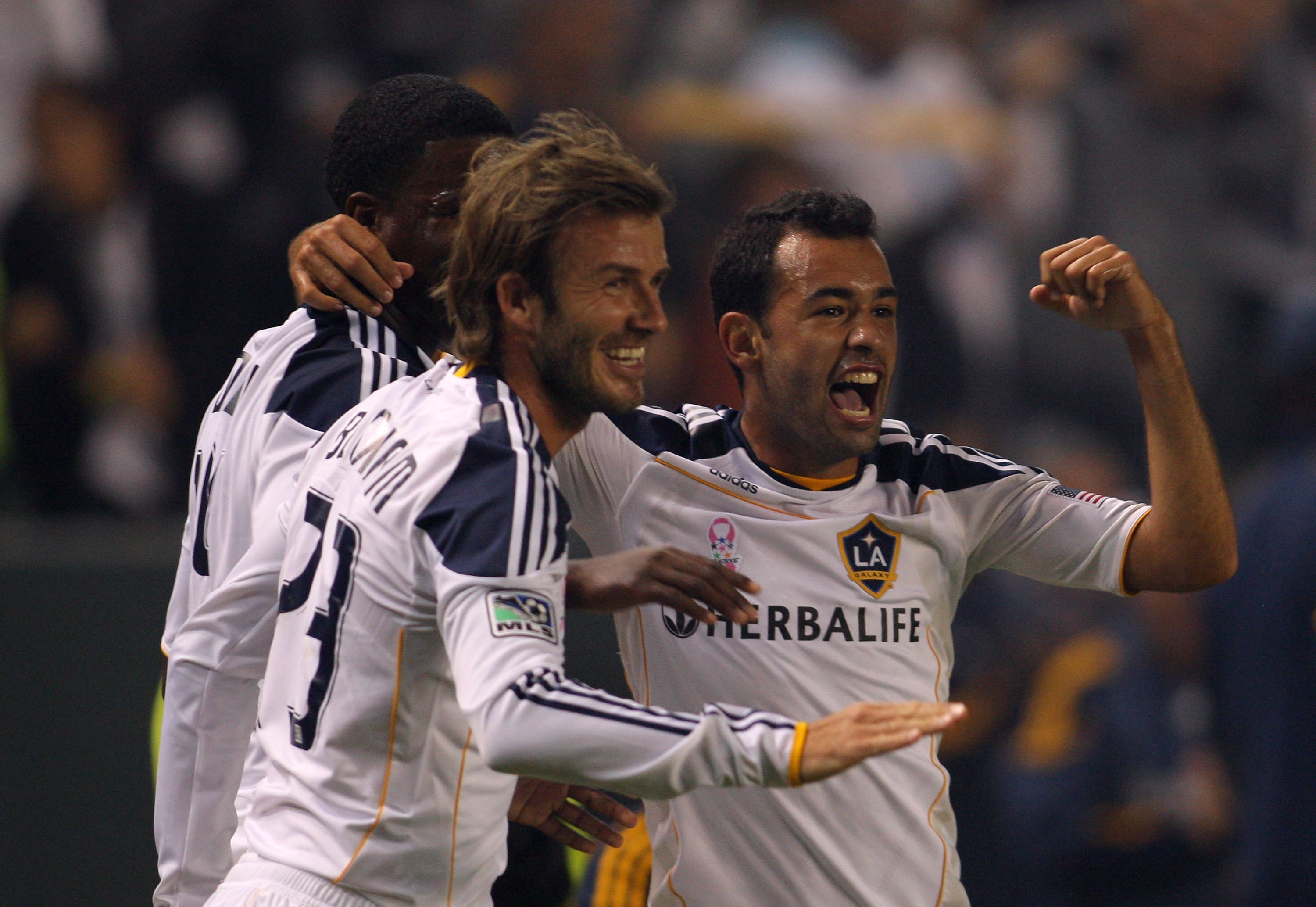 CARSON, CA - OCTOBER 16:  Edson Buddle #14, David Beckham #23 and Juninho #19 of the Los Angeles Galaxy celebrate Buddle's first half goal against the Colorado Rapids during the MLS match at The Home Depot Center on October 16, 2010 in Carson, California.