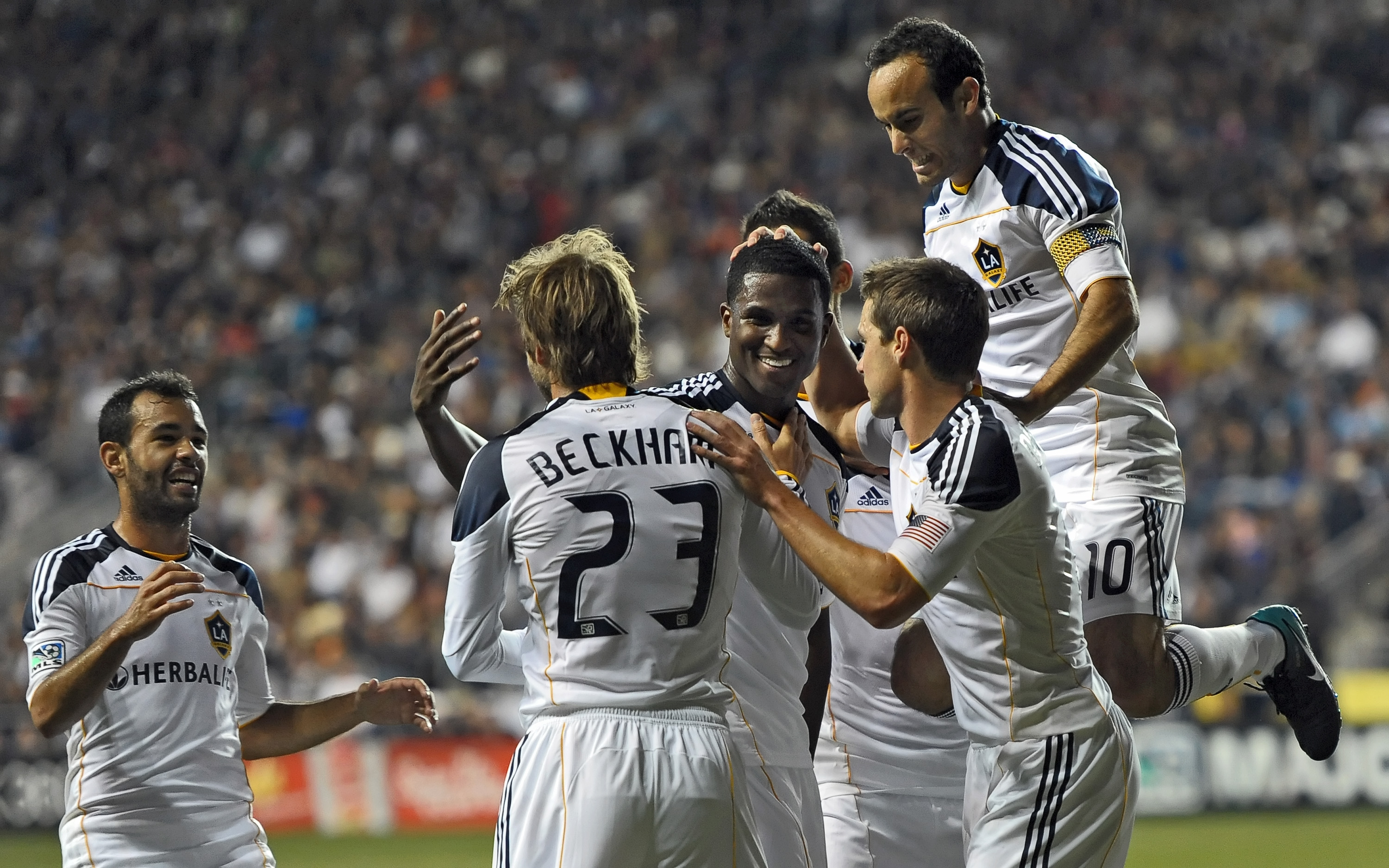 CHESTER, PA - OCTOBER 07: Edson Buddle #14 of the Los Angeles Galaxy celebrates with teammate  David Beckham #23 as Landon Donovan #10 jumps onto the group during the game against the Philadelphia Union at PPL Park on October 7, 2010  in Chester, Pennsylv
