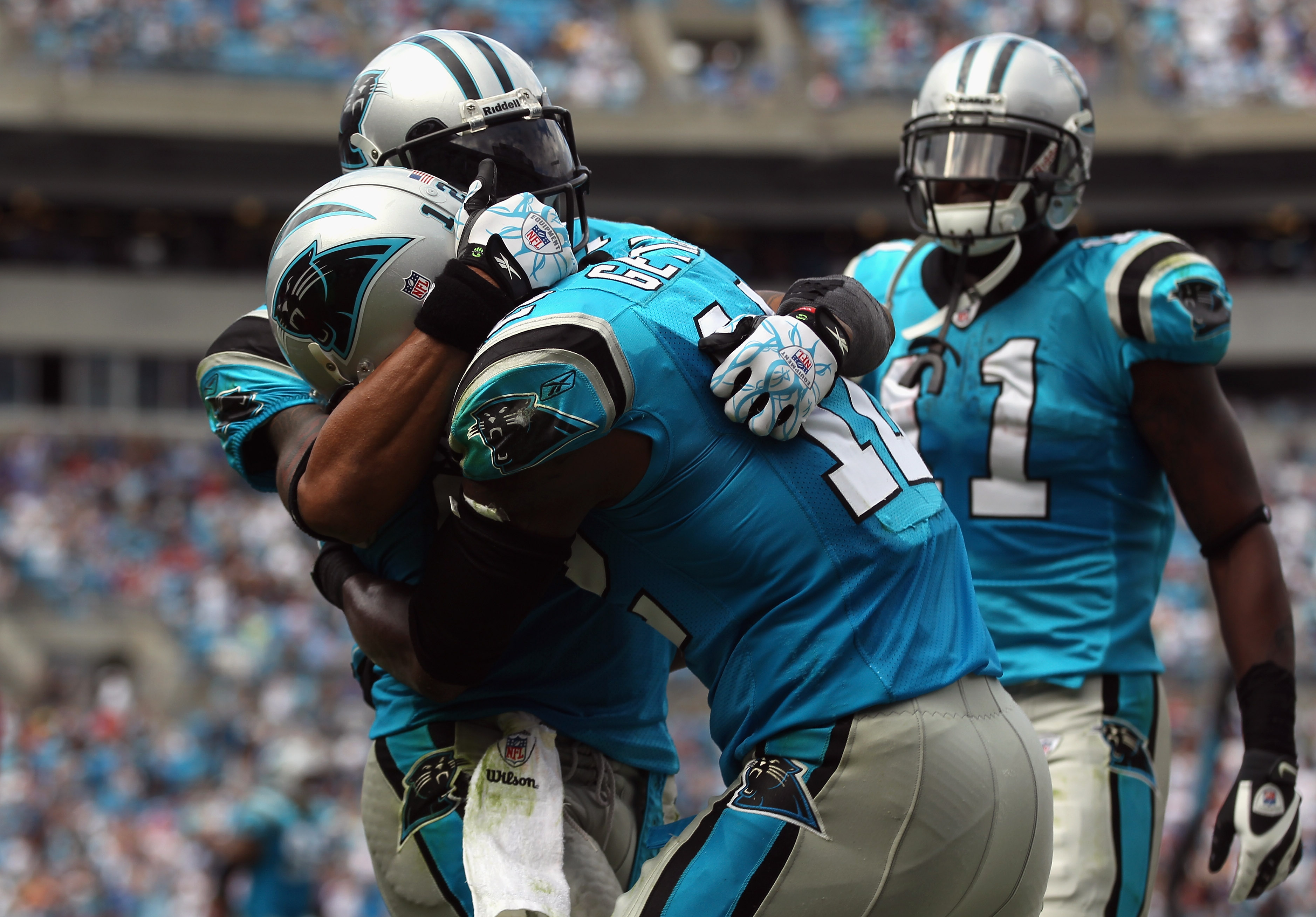 CHARLOTTE, NC - OCTOBER 24:  Teammates Steve Smith #89 and David Gettis #12 of the Carolina Panthers celebrate after Gettis scored a touchdown late in the fourth quarter against the San Francisco 49ers during their game at Bank of America Stadium on Octob