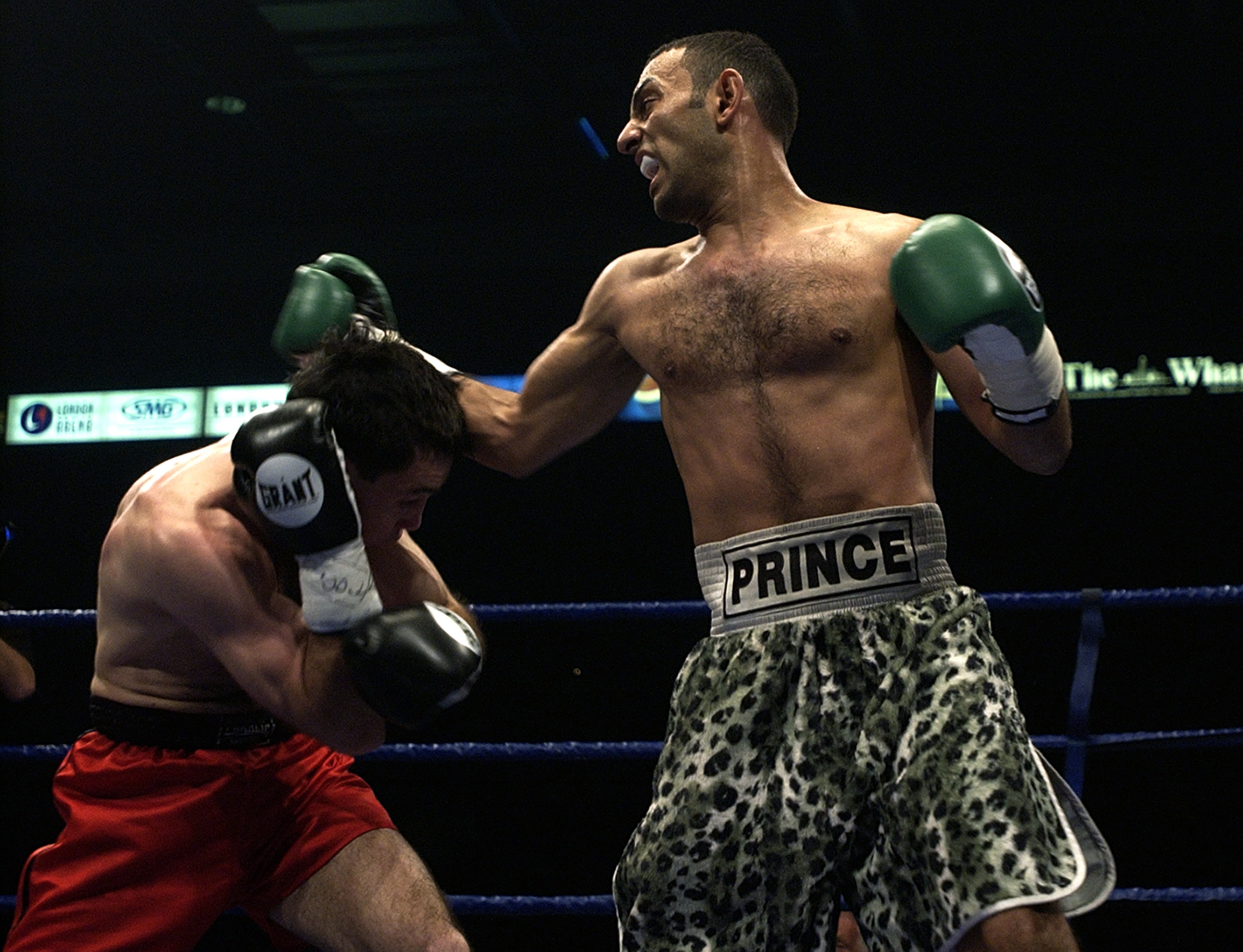 LONDON - May 18:  Prince Naseem Hamed (R) wins the IBO world featherweight title against Manuel Calvo at the London Arena in England on May 18, 2002. DIGITAL IMAGE (Photo by John Gichigi/Getty Images)