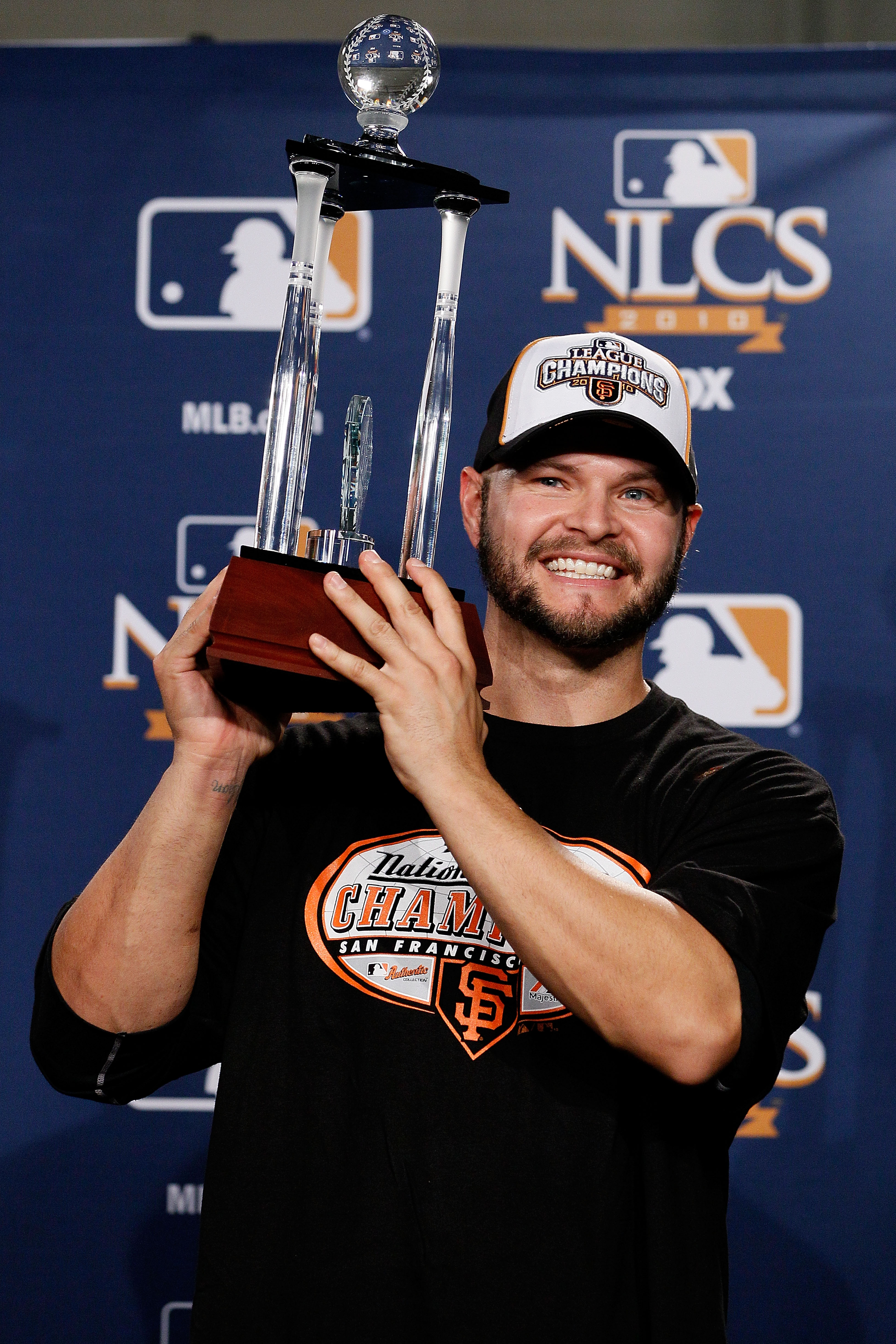 PHILADELPHIA - OCTOBER 23:  Cody Ross #13 of the San Francisco Giants celebrates with the NCLS MVP trophy after defeating the Philadelphia Phillies 3-2 and winning the pennant in Game Six of the NLCS during the 2010 MLB Playoffs at Citizens Bank Park on O