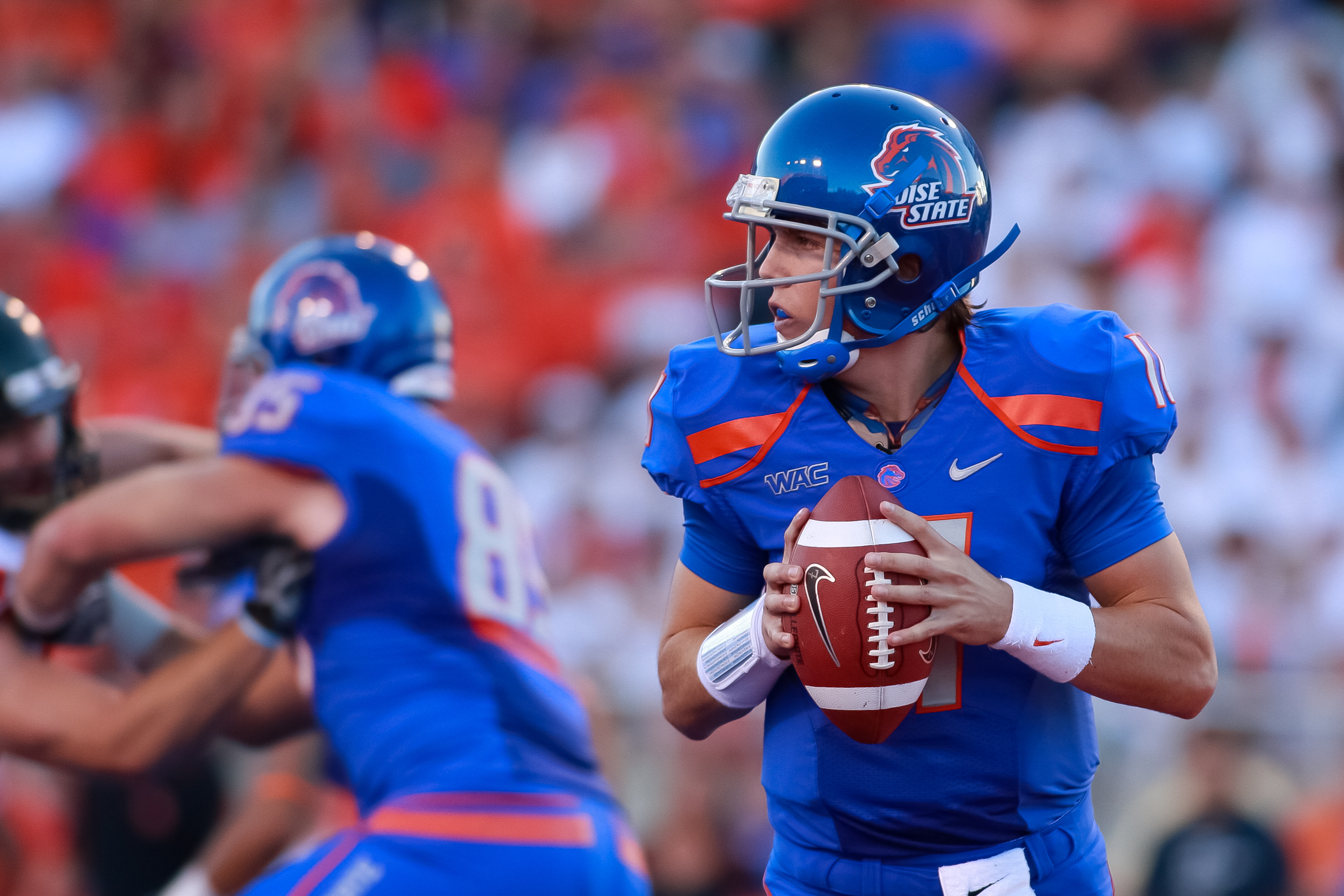 BOISE, ID - SEPTEMBER 25:  Quarterback Kellen Moore #11 of the Boise State Broncos looks for a receiver against the Oregon State Beaversat Bronco Stadium on September 25, 2010 in Boise, Idaho.  (Photo by Otto Kitsinger III/Getty Images)