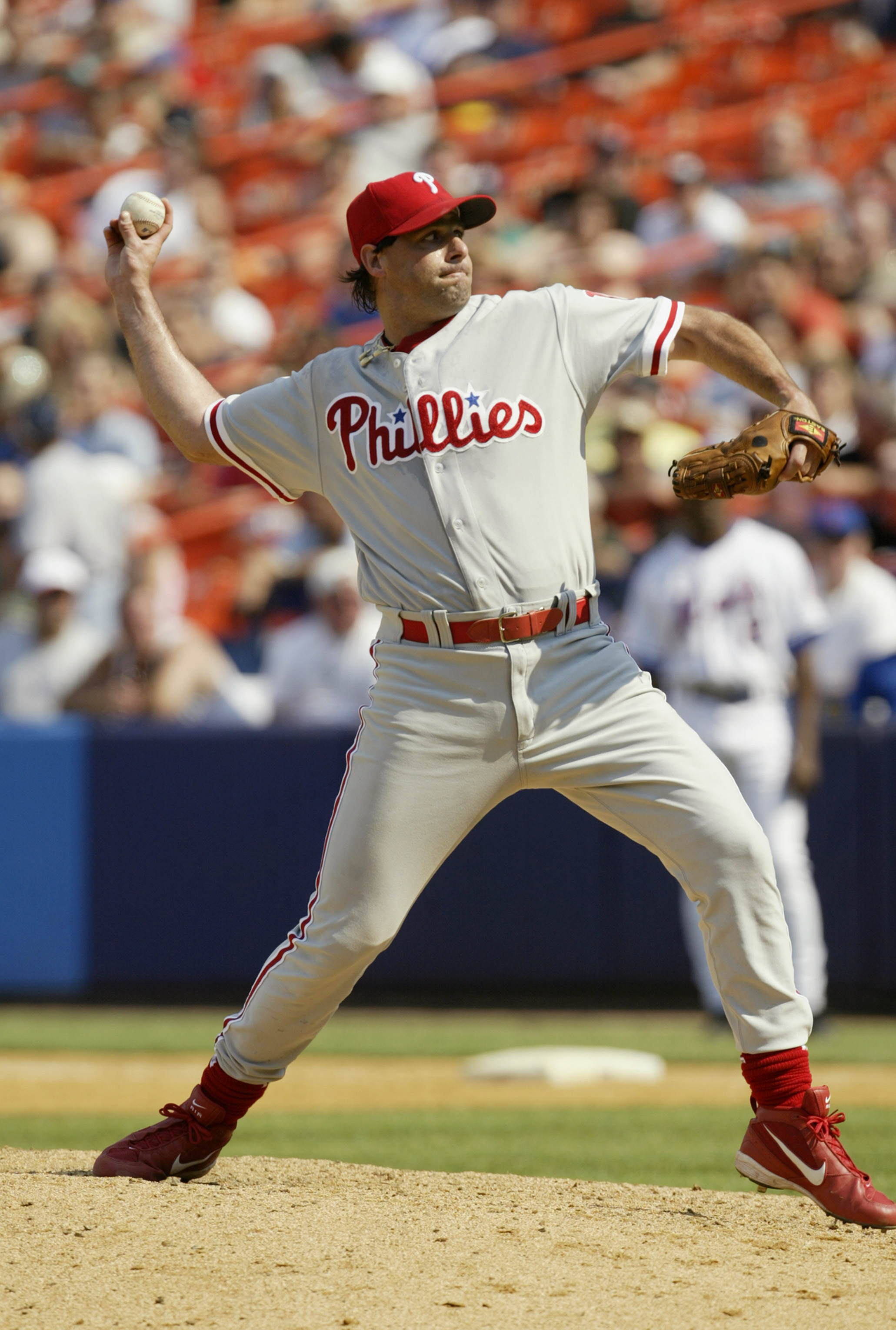 FLUSHING, NY - JULY 12:  Turk Wendell #13 of the Philadelphia Phillies pitches against the New York Mets on July 12, 2003 at Shea Stadium in Flushing, New York.  The Phillies defeated the Mets in 11 innings 4-2.  (Photo by Chris Trotman/Getty Images)