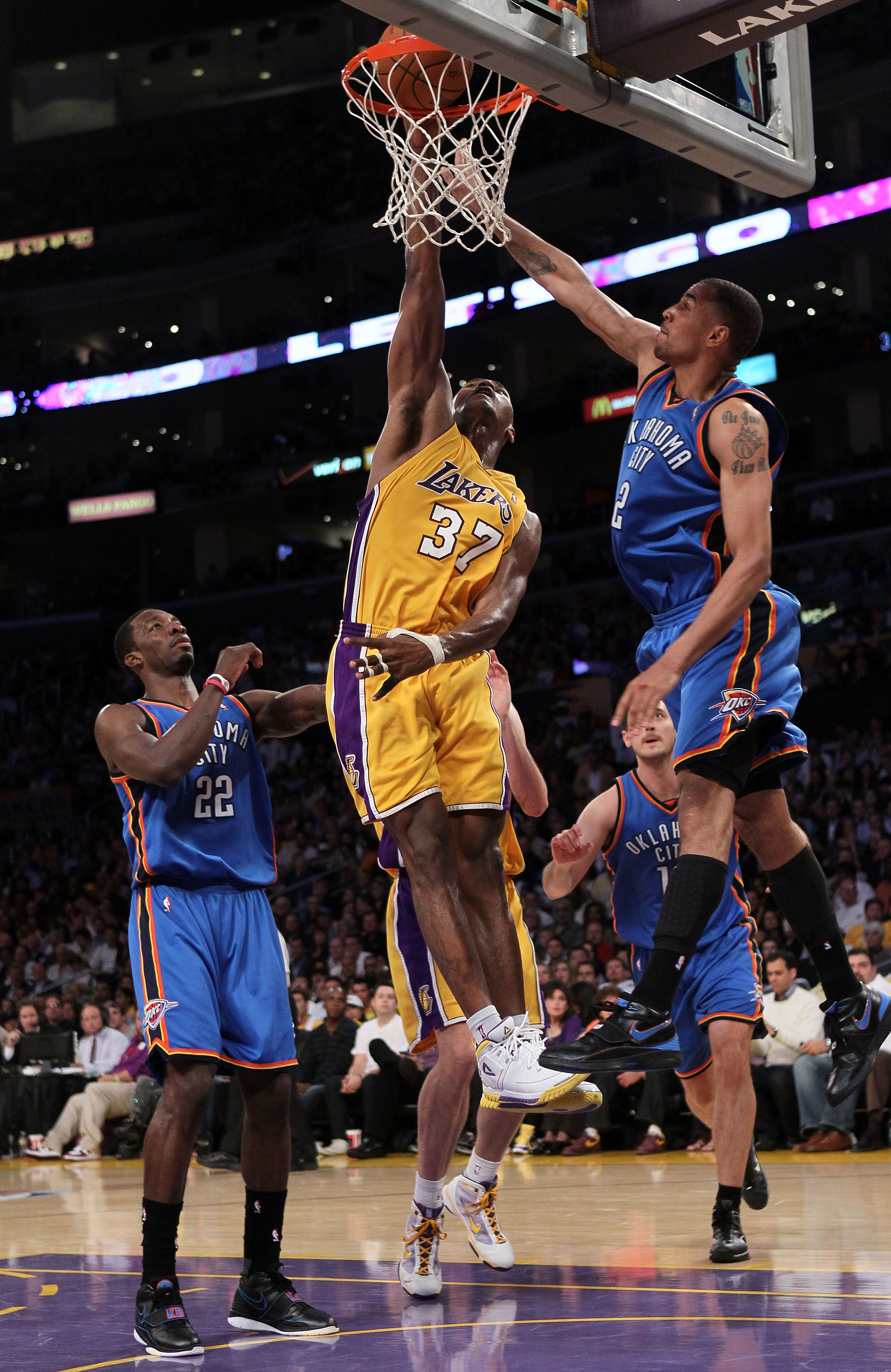 LOS ANGELES, CA - APRIL 27:  Ron Artest #37 of the Los Angeles Lakers goes up for a dunk between Jeff Green #22 and Thabo Sefolosha #2 of the Oklahoma City Thunder in the second quarter during Game Two of the Western Conference Quarterfinals of the 2010 N