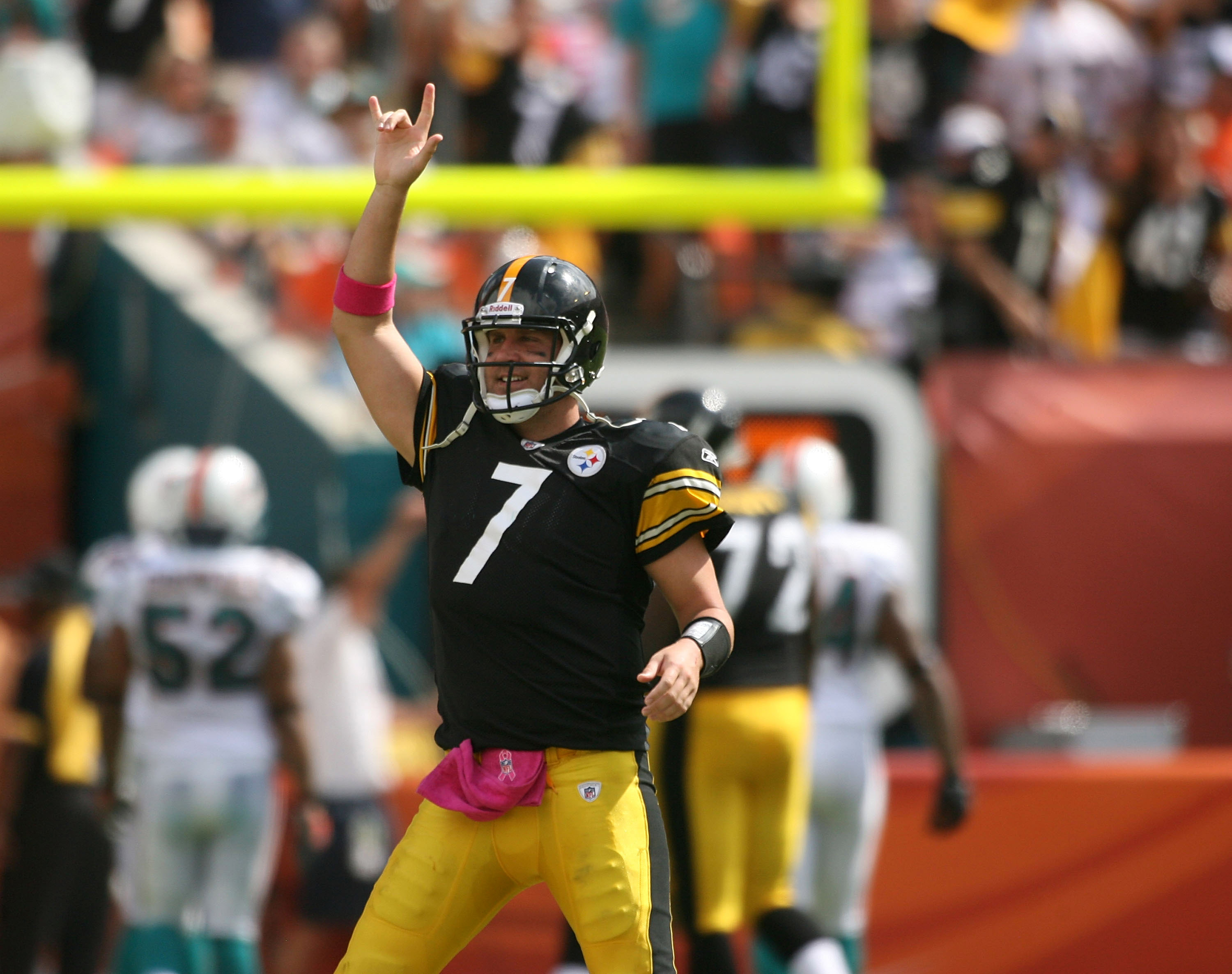 MIAMI - OCTOBER 24:  Quarterback Ben Roethlisberger #7 celebrates a touchdown against the Miami Dolphins at Sun Life Stadium on October 24, 2010 in Miami, Florida.  (Photo by Marc Serota/Getty Images)